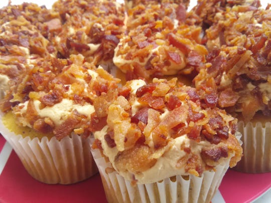 A plateful of maple bacon cupcakes from Stone House Bakery and Restaurant is displayed at last year's Indiana Bacon Festival of Carroll County.