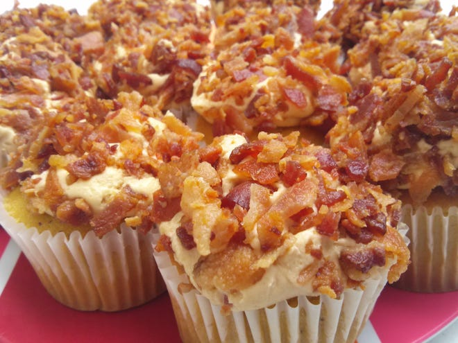 A plateful of maple bacon cupcakes from Stone House Bakery and Restaurant is displayed at a past Indiana Bacon Festival of Carroll County.