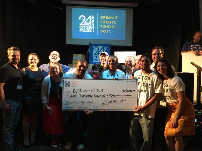 """The """"Eyes of the Sun"""" team celebrates prize money received at the 24-Hour Citizen Project competition."""