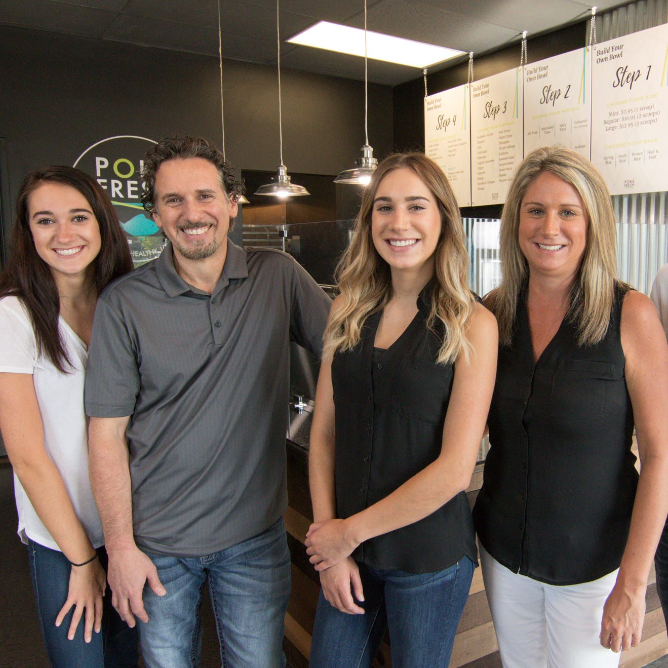 From left, daughter Morgan, dad Chris, daughter Kylie, mom Tracy and son Chris Bachuwa, shown Monday, Aug. 13, 2018, all contributed to the formation of Poké Fresh, a Hawaiian cuisine-inspired restaurant opening in Genoa Township.