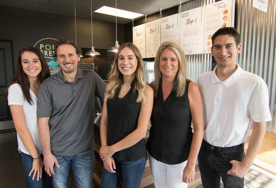 From left, daughter Morgan, dad Chris, daughter Kylie, mom Tracy and son Chris Bachuwa, shown Monday, Aug. 13, 2018, all contributed to the formation of Poké Fresh, a Hawaiian cuisine-inspired restaurant business with locations in Genoa Township and Brighton.
