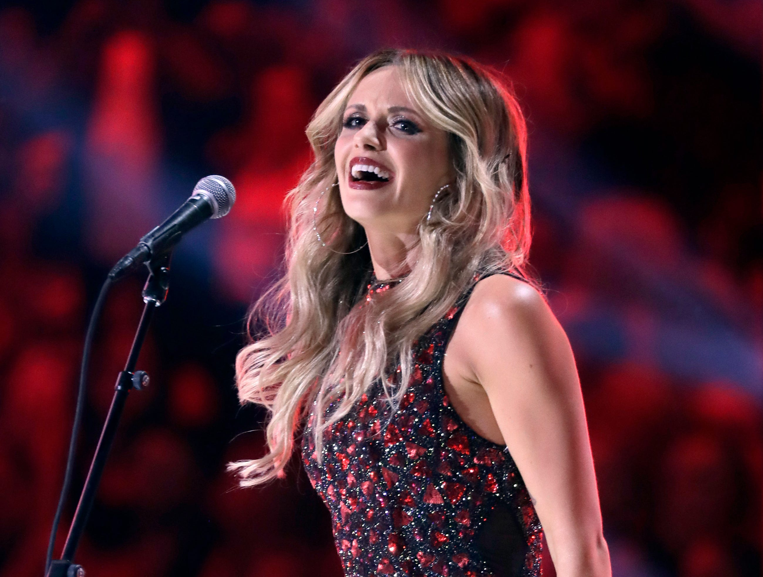 "Carly Pearce performs ""Hide the Wine"" at the CMT Music Awards at the Bridgestone Arena on Wednesday, June 6, 2018, in Nashville, Tenn. (AP Photo/Mark Humphrey)"