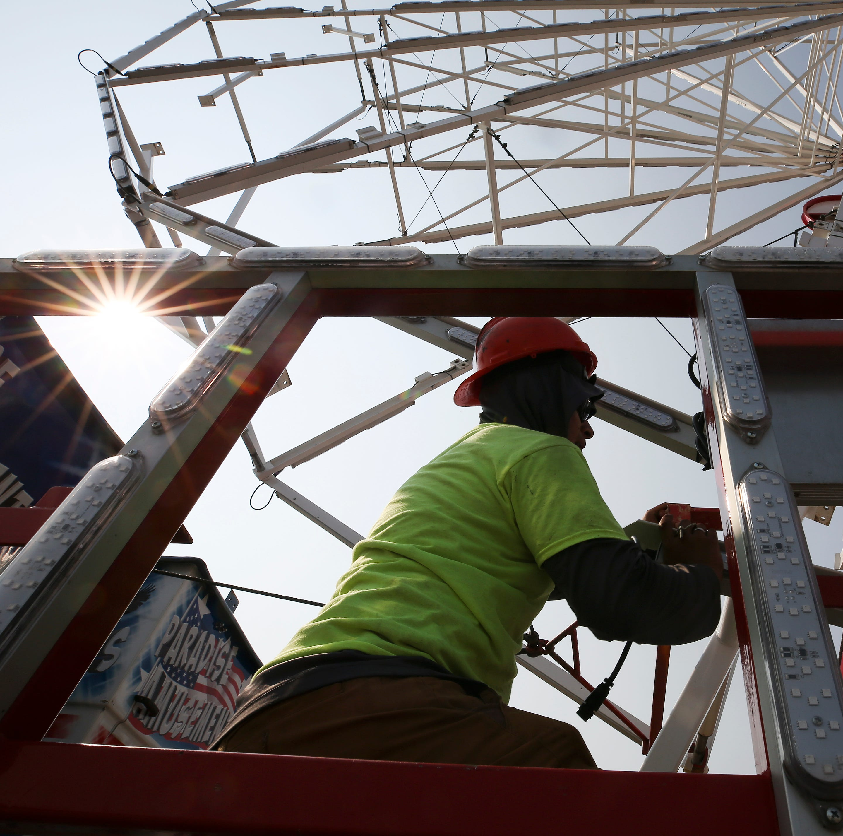Crews assemble the rides for the Kentucky State Fair