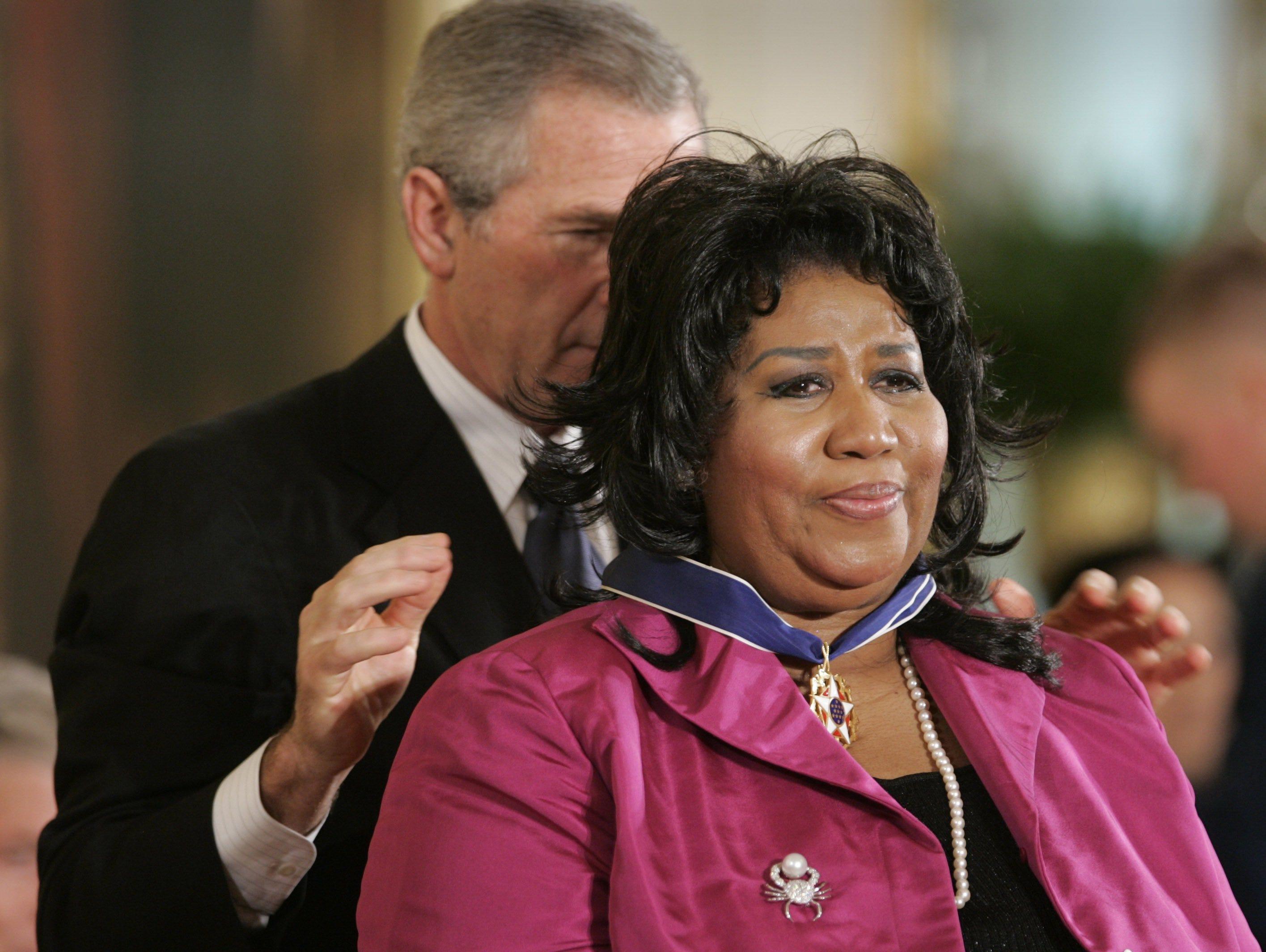 President Bush awards singer Aretha Franklin the Presidential Medal of Freedom Award in the East Room of the White House, Wednesday, Nov. 9, 2005, in Washington. The Presidential Medal of Freedom is the highest civilian award given.
