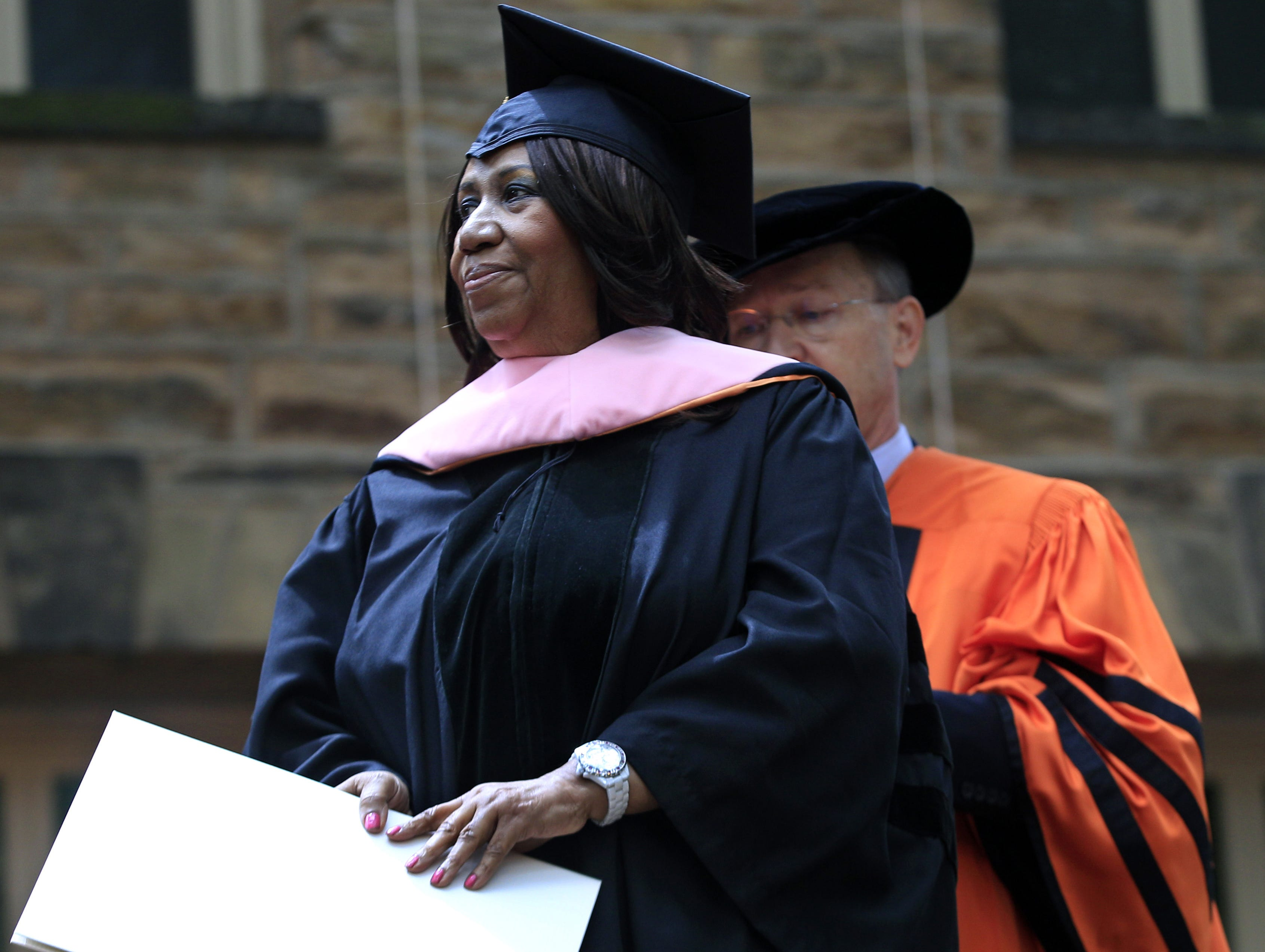 """Soul singer Aretha Franklin stands on stage at Princeton University in Princeton, N.J., Tuesday, June 5, 2012, as the """"Queen of Soul"""" receives an honorary Doctorate of Music degree during Princeton University's commencement."""