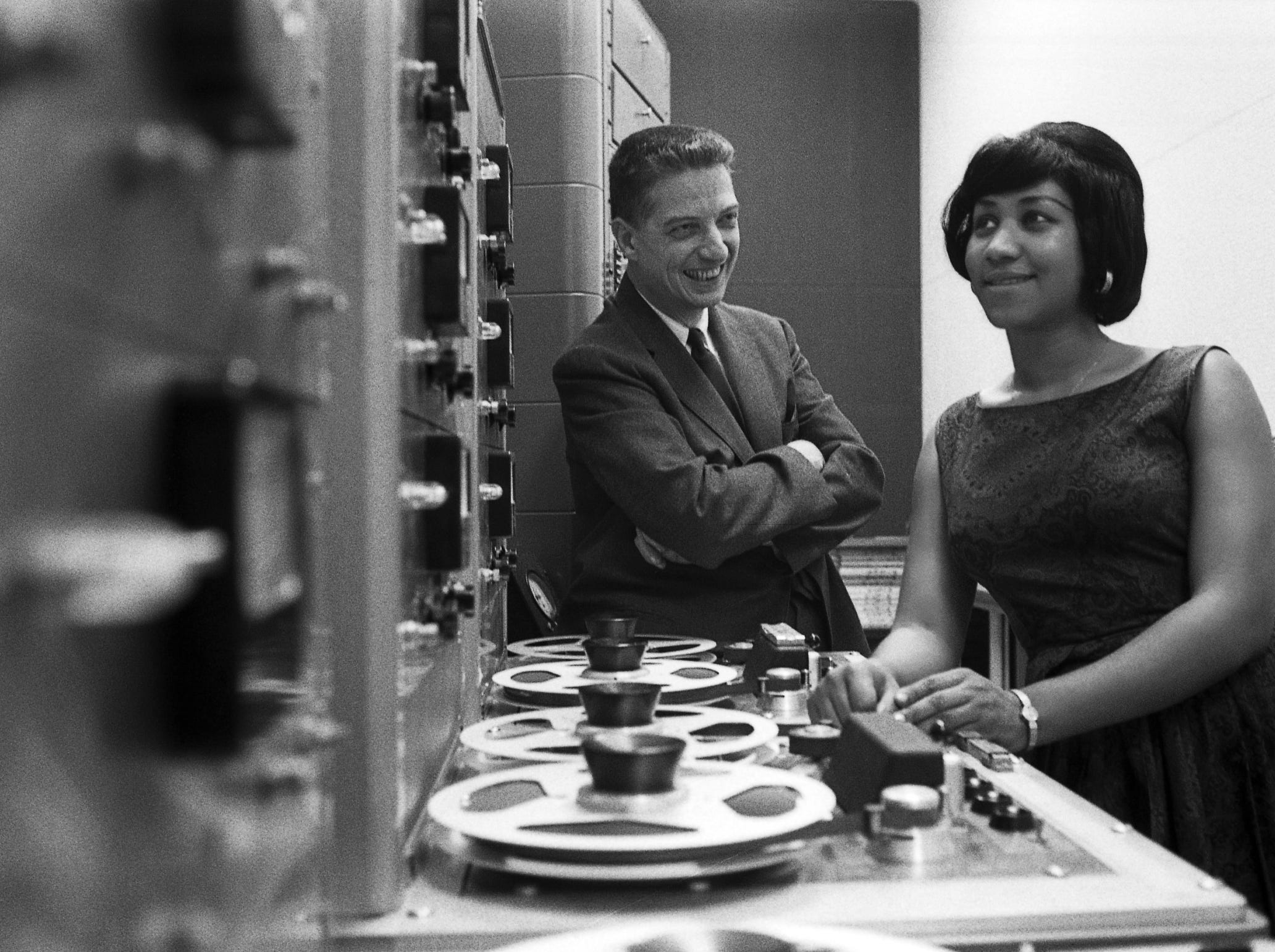 Aretha Franklin listening to playback with producer John Hammond, New York, 1962. From the exhibition Keeping Time: The Photographs of Don Hunstein, The Museum at Bethel Woods 2013.
