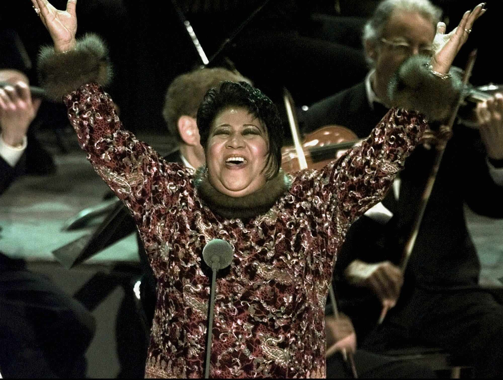 """Aretha Franklin, performing in this Feb. 25, 1998 file photo, says she wasn't trying to prove her versatility when she filled in for Luciano Pavarotti at the Grammys this year. """"I'm sure many people were surprised, but I'm not there to prove anything,'' the queen of soul told The Associated Press on Thursday, April 9, 1998. (AP Photo/Mark Lennihan)"""