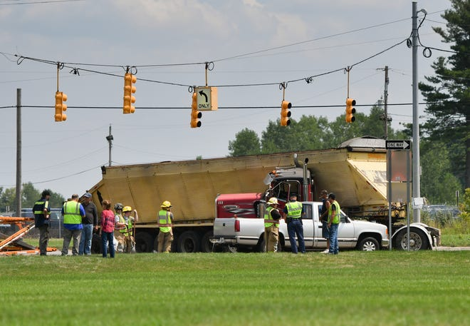 Police investigate the scene of a crash involving a semi truck and a pickup at the intersection of Canal and Lansing roads on Monday Aug. 13, 2018. No injuries were reported. Southbound Canal was closed for more than an hour.