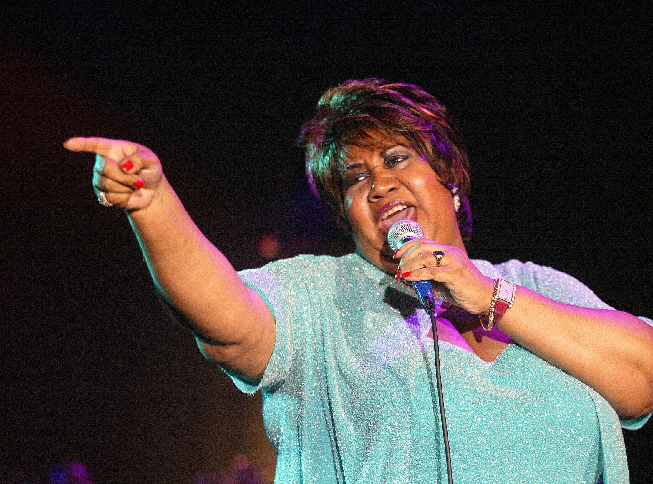 Aretha Franklin performs on June 22, 2002, during the opening of the new Mohegan Sun resort and casino in Uncasville, Conn., on the Mohegan Indian Reservation.
