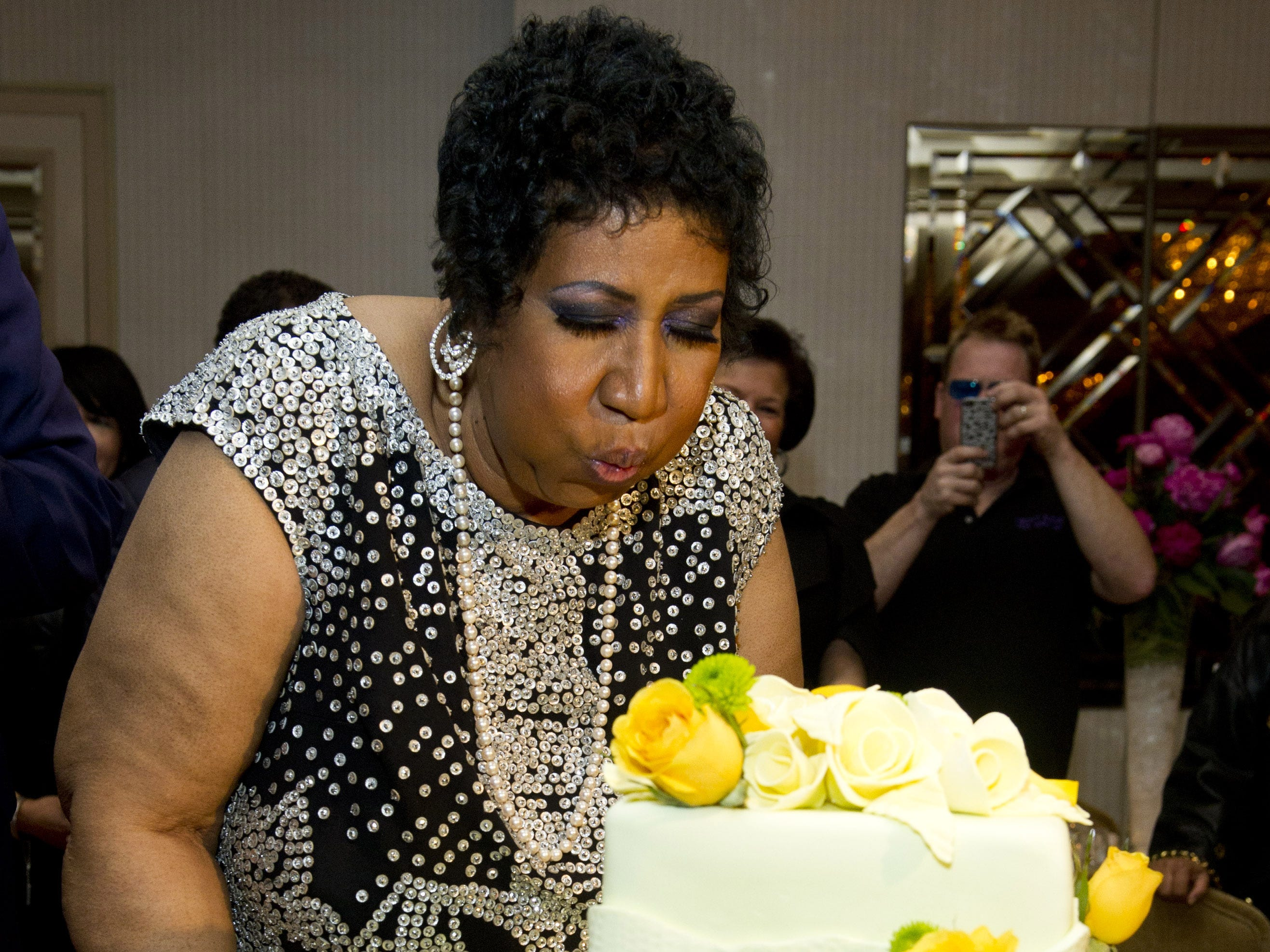 Aretha Franklin attends her 70th birthday party in New York, Saturday, March 24, 2012.