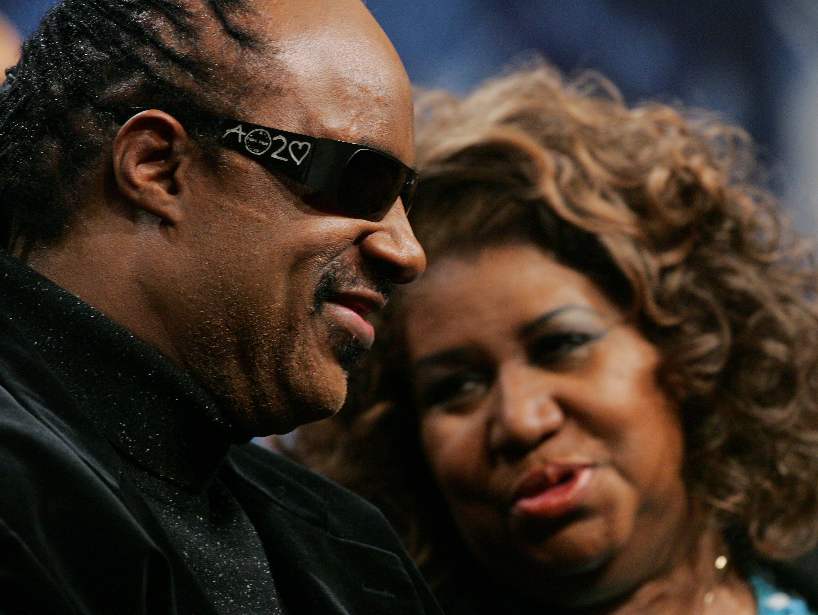Singer Aretha Franklin, right, talks with Stevie Wonder during a news conference in Detroit Thursday, Feb. 2, 2006. Franklin was to perform the national athem prior to the game and Wonder provided pre-game entertainment. Super Bowl XL featured the AFC Champion Pittsburgh Steelers against the NFC Champion Seattle Seahawks.