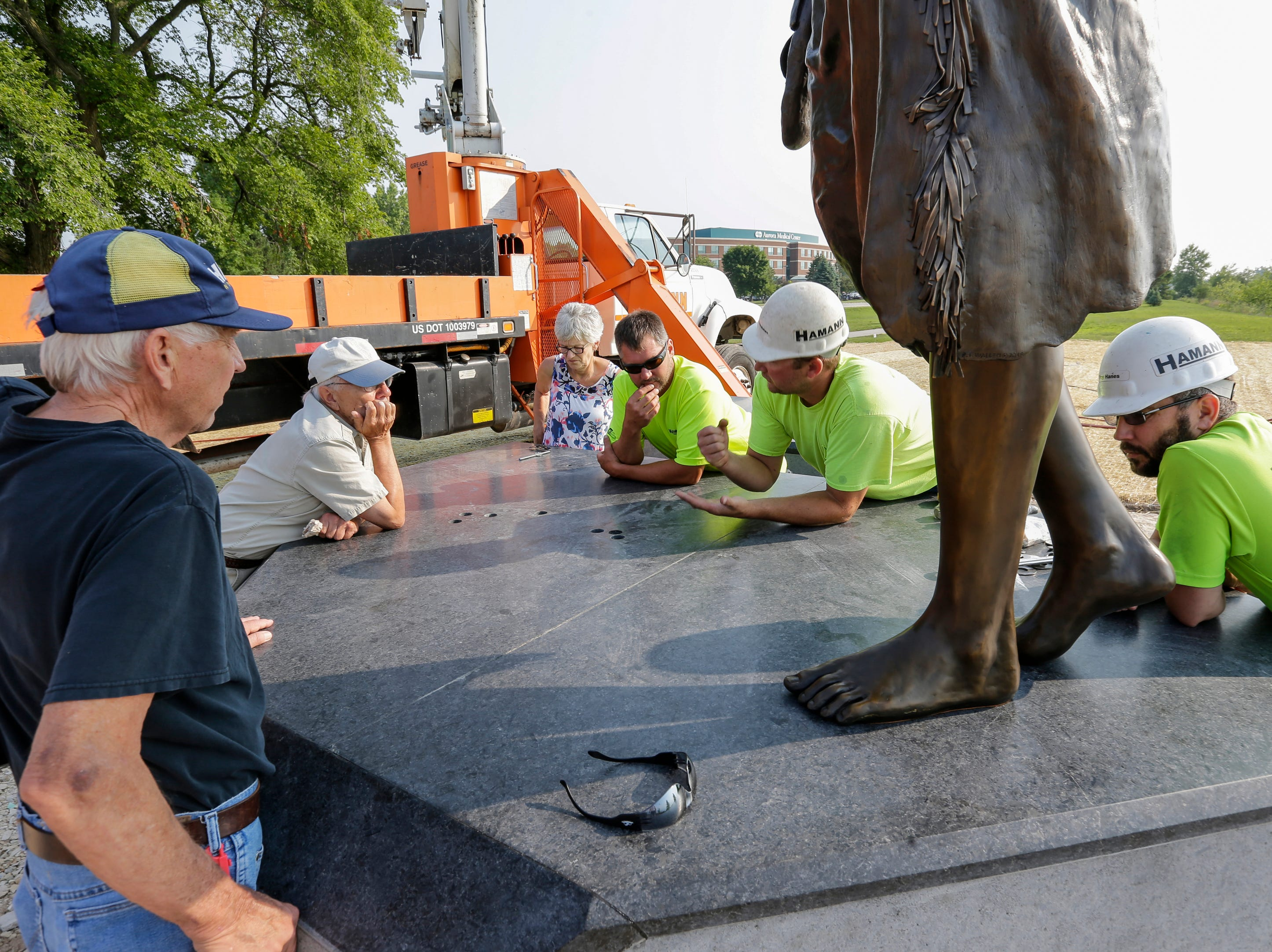 "Hamann Construction crane operator Rob Boeckman, right, discusses options for installing the second piece of the Spirit of the Rivers sculpture with artist R.T. ""Skip"" Wallen Monday, August 13, 2018, in Two Rivers, Wis. Josh Clark/USA TODAY NETWORK-Wisconsin"