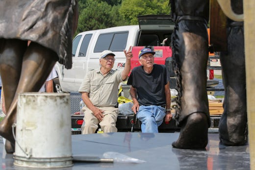 "Artist R.T. ""Skip"" Wallen, left, points his brother Bob Wallen to part of the Spirit of the Rivers sculpture Monday, August 13, 2018, in Two Rivers, Wis. Josh Clark/USA TODAY NETWORK-Wisconsin"