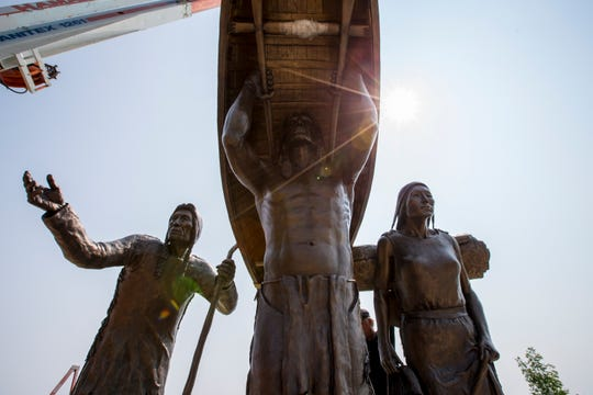 The sun rises over the Spirit of the Rivers sculpture after it's installed on the Lake Michigan shoreline Aug. 13, 2018, in Two Rivers.