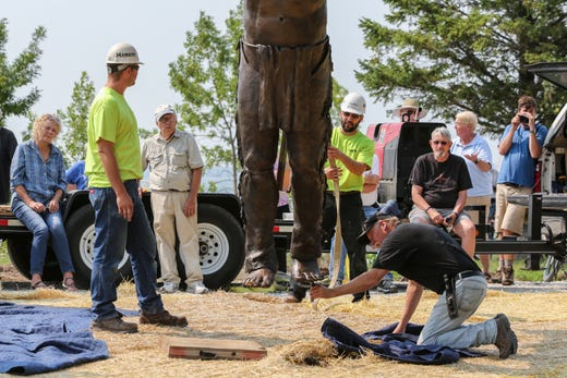 Crews work on installing the Spirit of the Rivers sculpture Monday, August 13, 2018, in Two Rivers, Wis. Josh Clark/USA TODAY NETWORK-Wisconsin