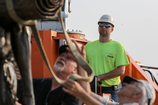 Hamann Construction crane operator Rob Boeckman raises the second piece of the sculpture Monday, August 13, 2018, in Two Rivers, Wis. Josh Clark/USA TODAY NETWORK-Wisconsin