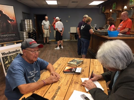 """Richard Jourdan of Mansfield, was an extra in """"The Shawshank Redemption"""" serving on the parole board. He also was cast as a convict too. Here, author Mark Dawidsziak, at right, interviews Jourdan about his experiences in the film Saturday at the Shawshank woodshop in Upper Sandusky."""