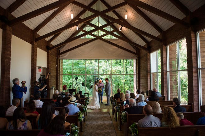 August 13, 2018 - Scenes from the wedding of Julie Guardado and Marc Caudel at the new Chapel in the Woods adjacent to The Guest House at Graceland. Theirs was the first ceremony in the new chapel.