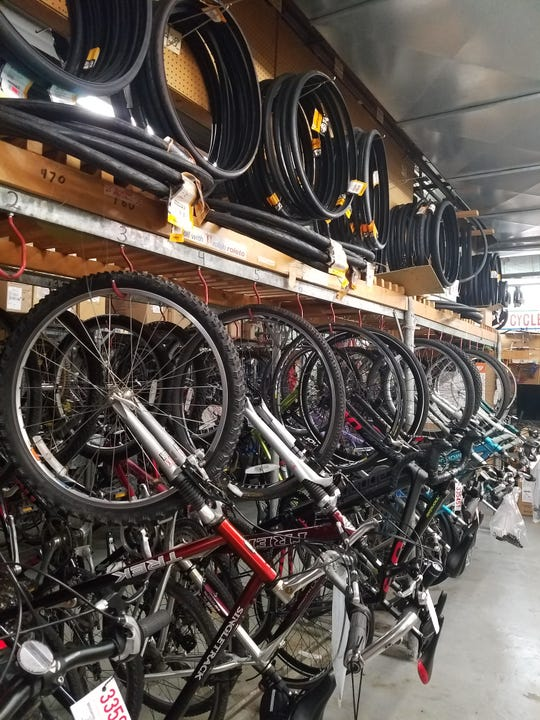 Bikes waiting to be repaired rest on hooks inside Brookfield Cycle and Fitness, 2205 N Calhoun Rd on Aug. 9. The business announced it will close at the end of August.