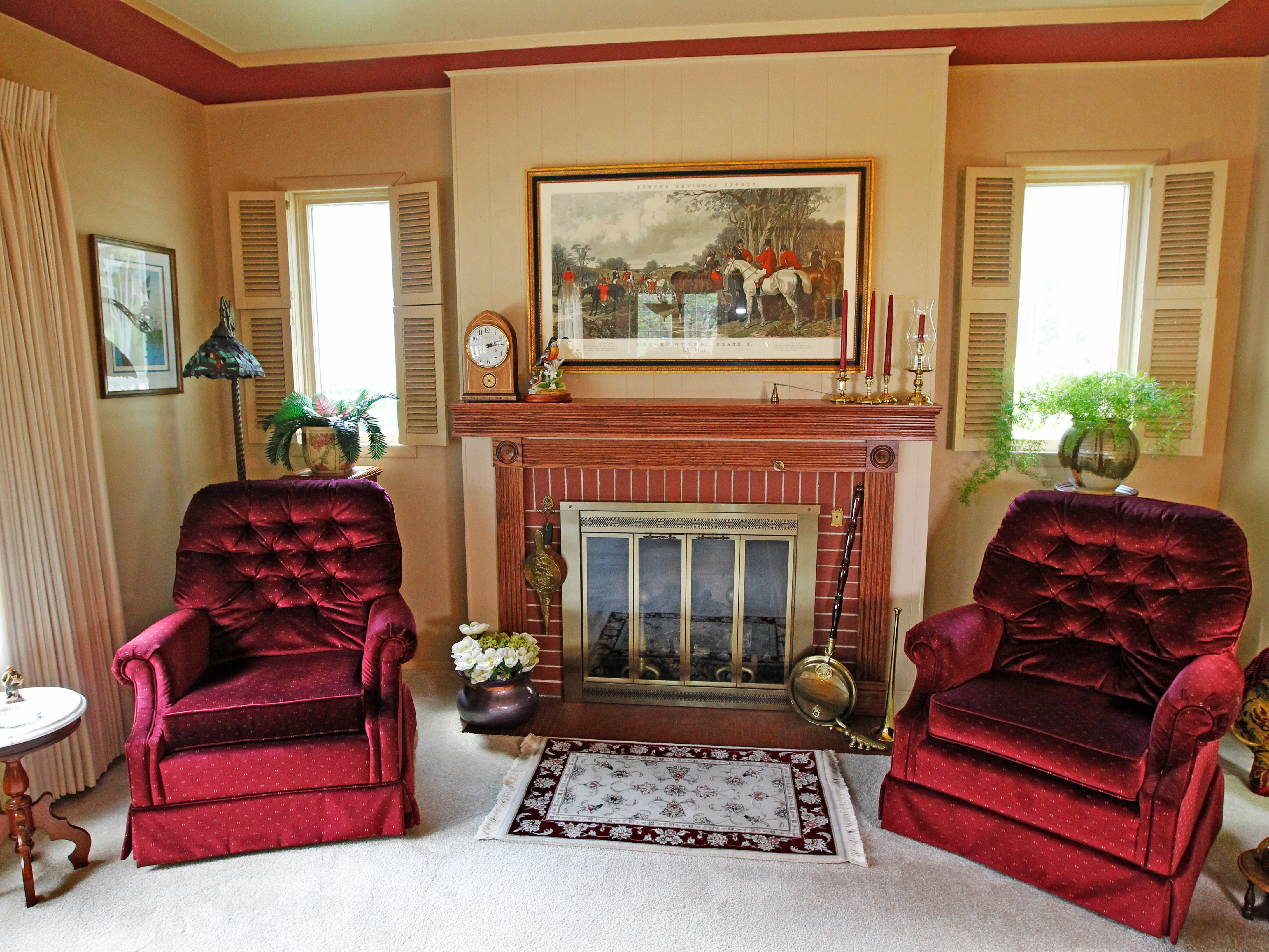 These two chairs provide a cozy spot next to the fireplace in the living room.