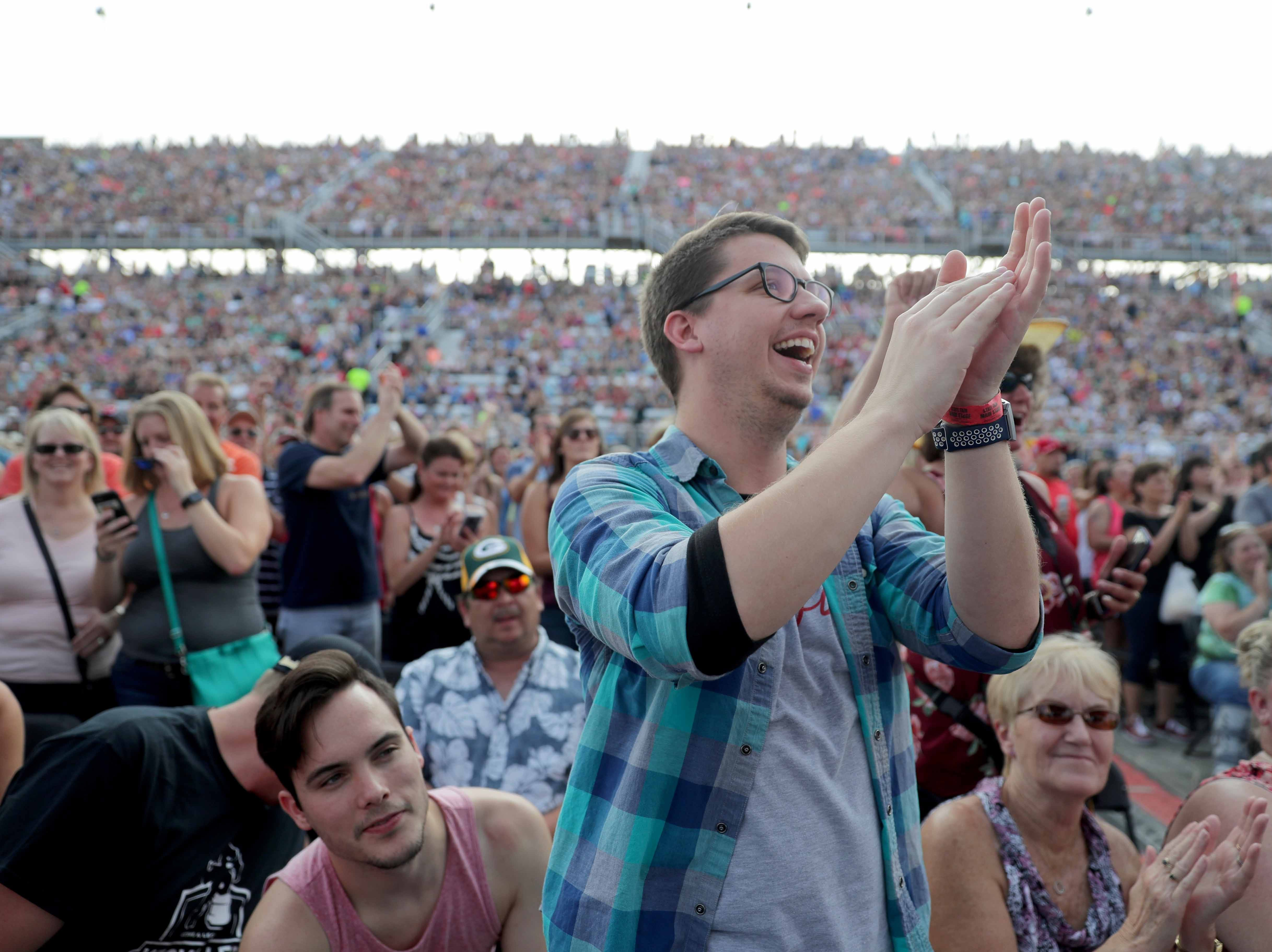 Fans cheer as country legend Reba McEntire performs a sold-out show at the Wisconsin State Fair.