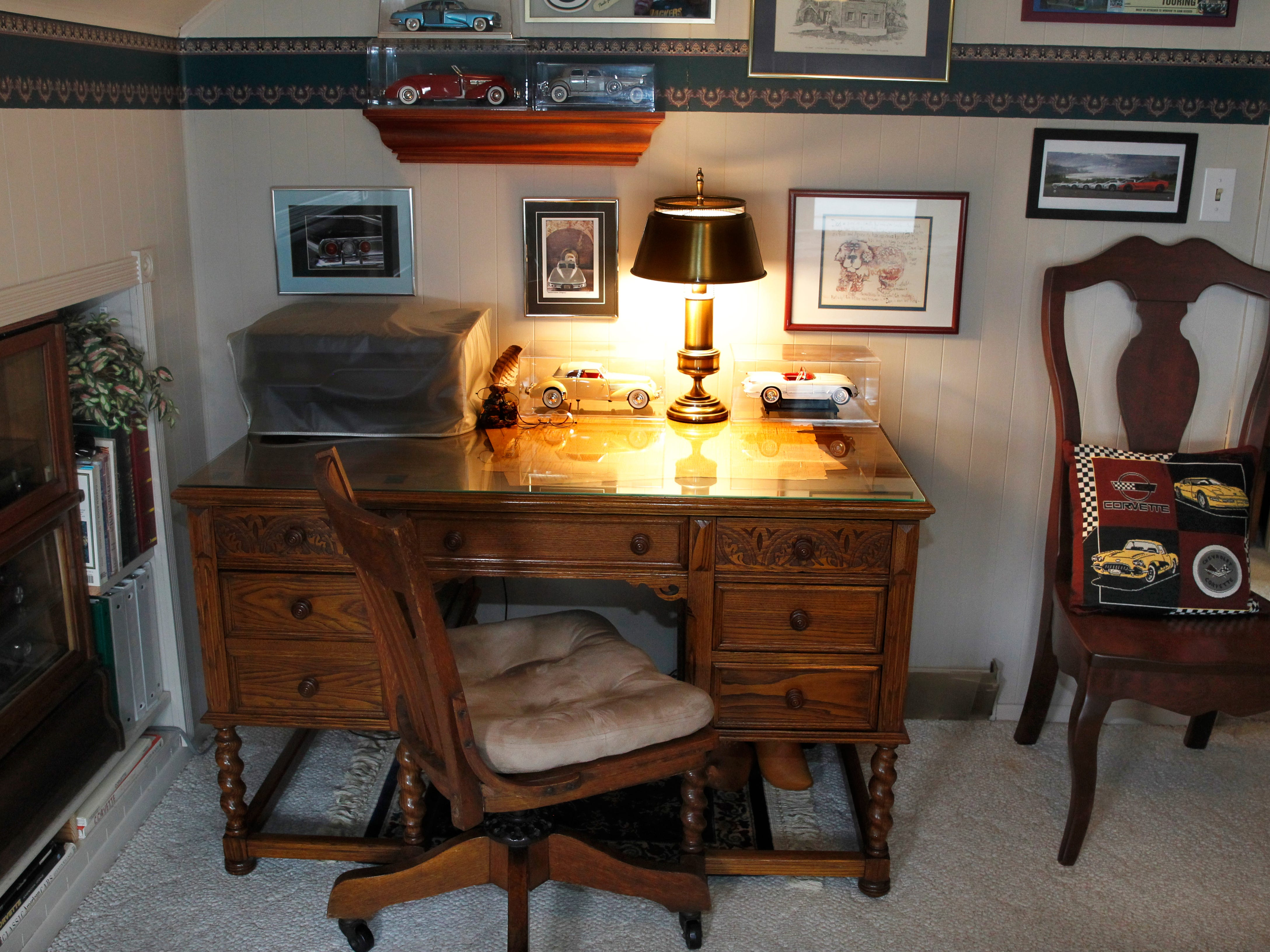 This desk, homeowner Vilas Kraut's favorite piece in the house, is from his grandfather, who got it from an Episcopal church.