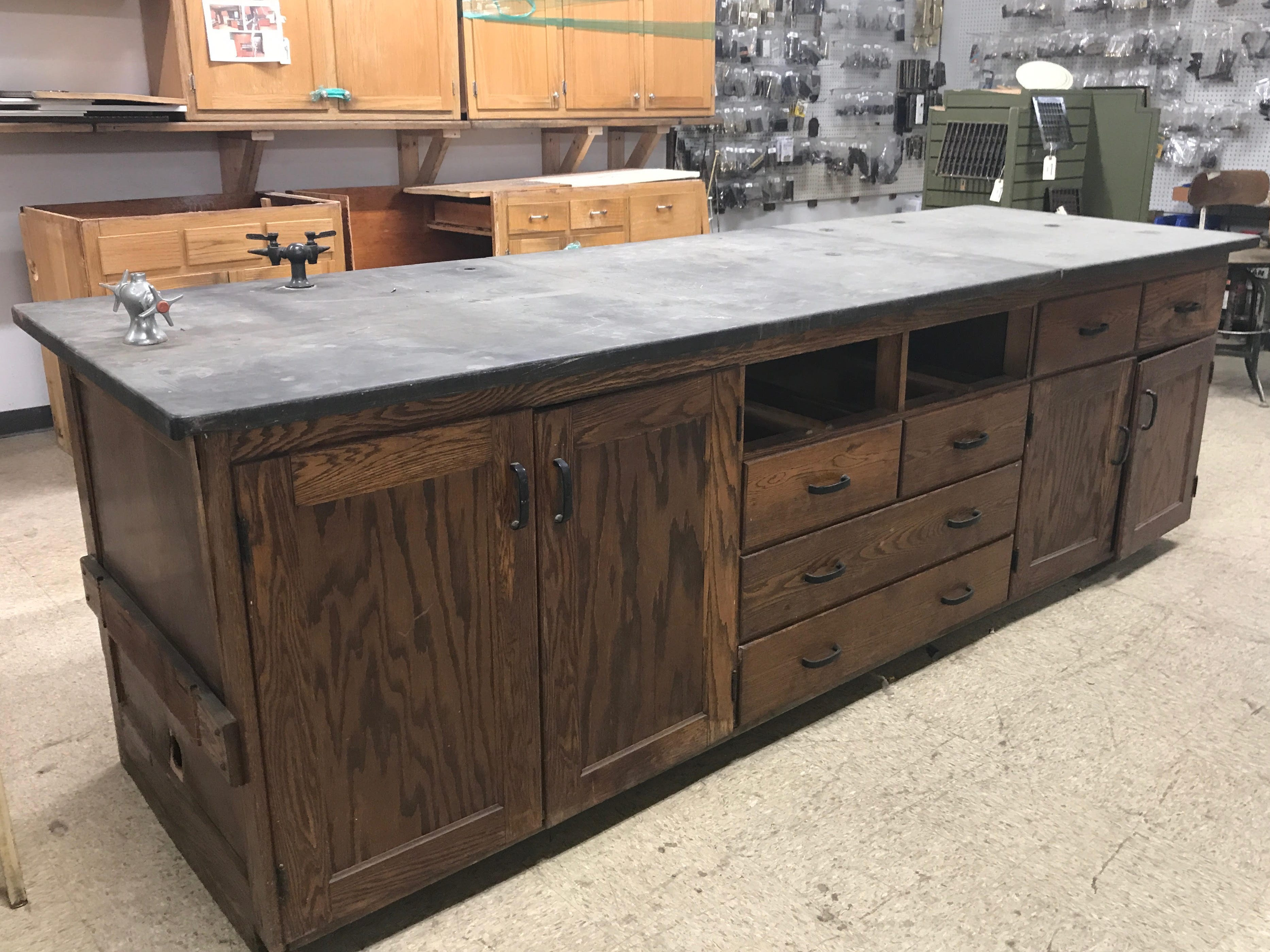 This antique chemistry lab table was used by two area homeowners to create kitchen islands. One purchased the top and the other the base.