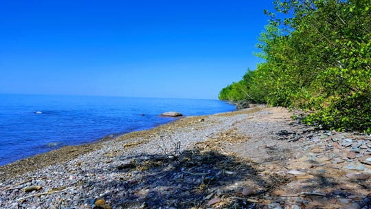 A rocky beach lines Lake Superior in the Porcupine Mountains Wilderness State Park in Michigan's Upper Peninsula.