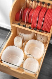 This island pull-out keeps storage containers and lids neatly organized.