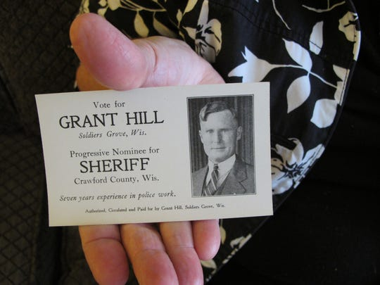 Laurie DeMoss, of New Berlin, holds a card her grandfather Grant Hill used to promote his bid for Crawford County sheriff in the 1930s. Hill was seriously wounded in the Battle of Hamel during World War I and DeMoss and her family traveled to France on the battle's July 4, 1918 centennial.