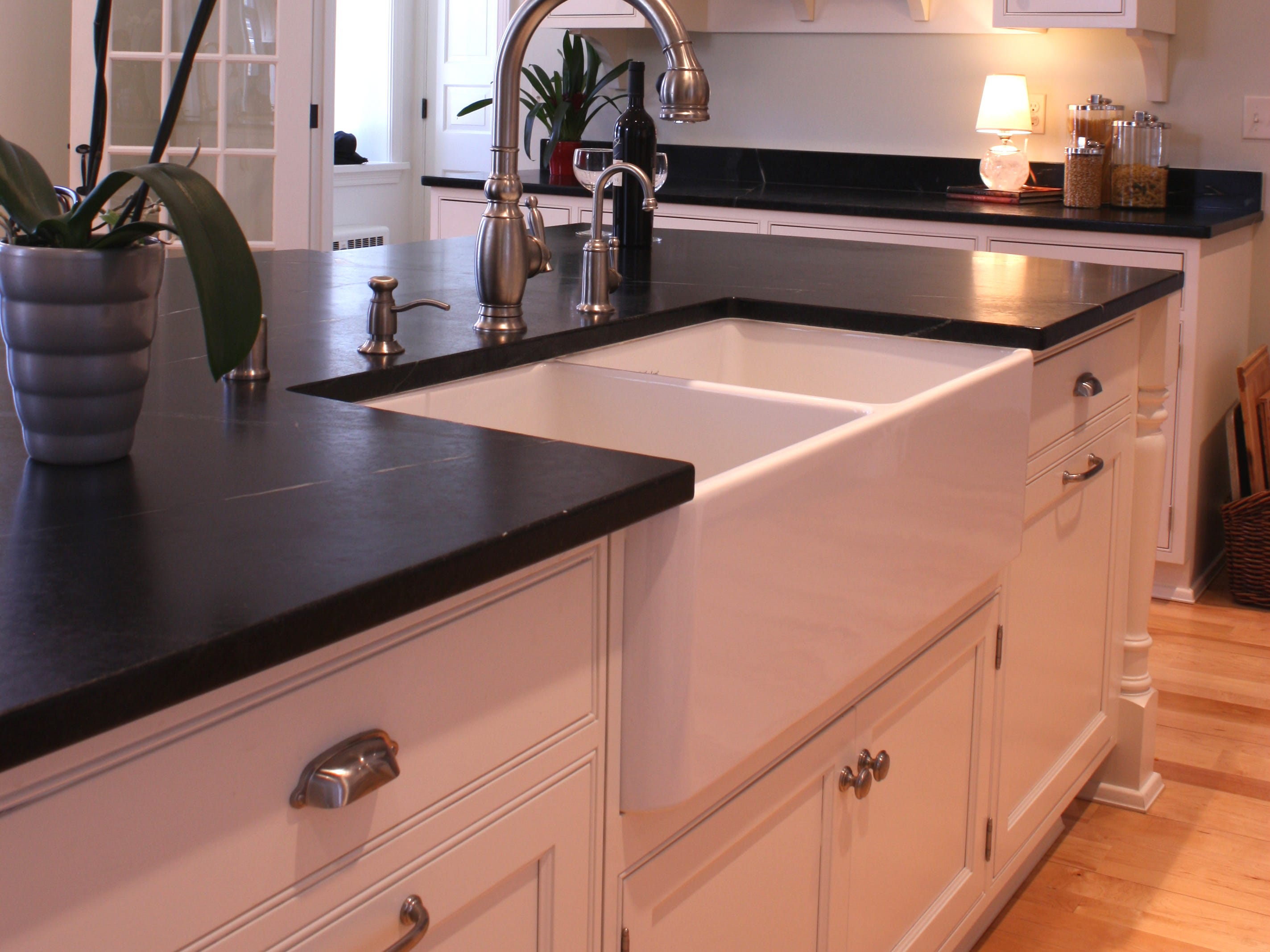This massive island in Cedarburg is more than 9 feet long and topped with  honed soapstone. (SAP Woodworking)