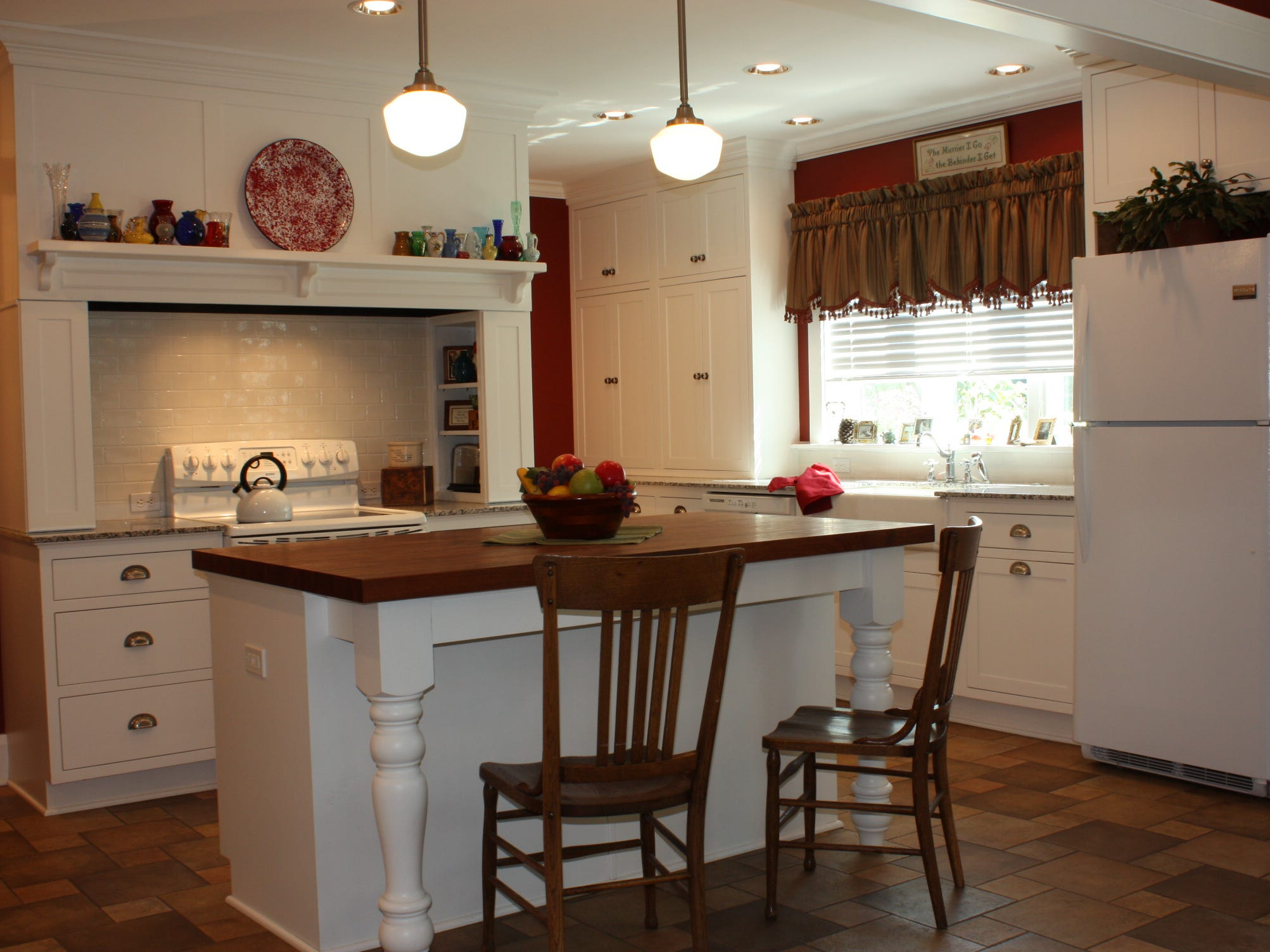 The third-generation owner of this Racine farmhouse chose an island with a mesquite butcher block top in keeping with the home's original charm. (Greenfield Cabinetry)