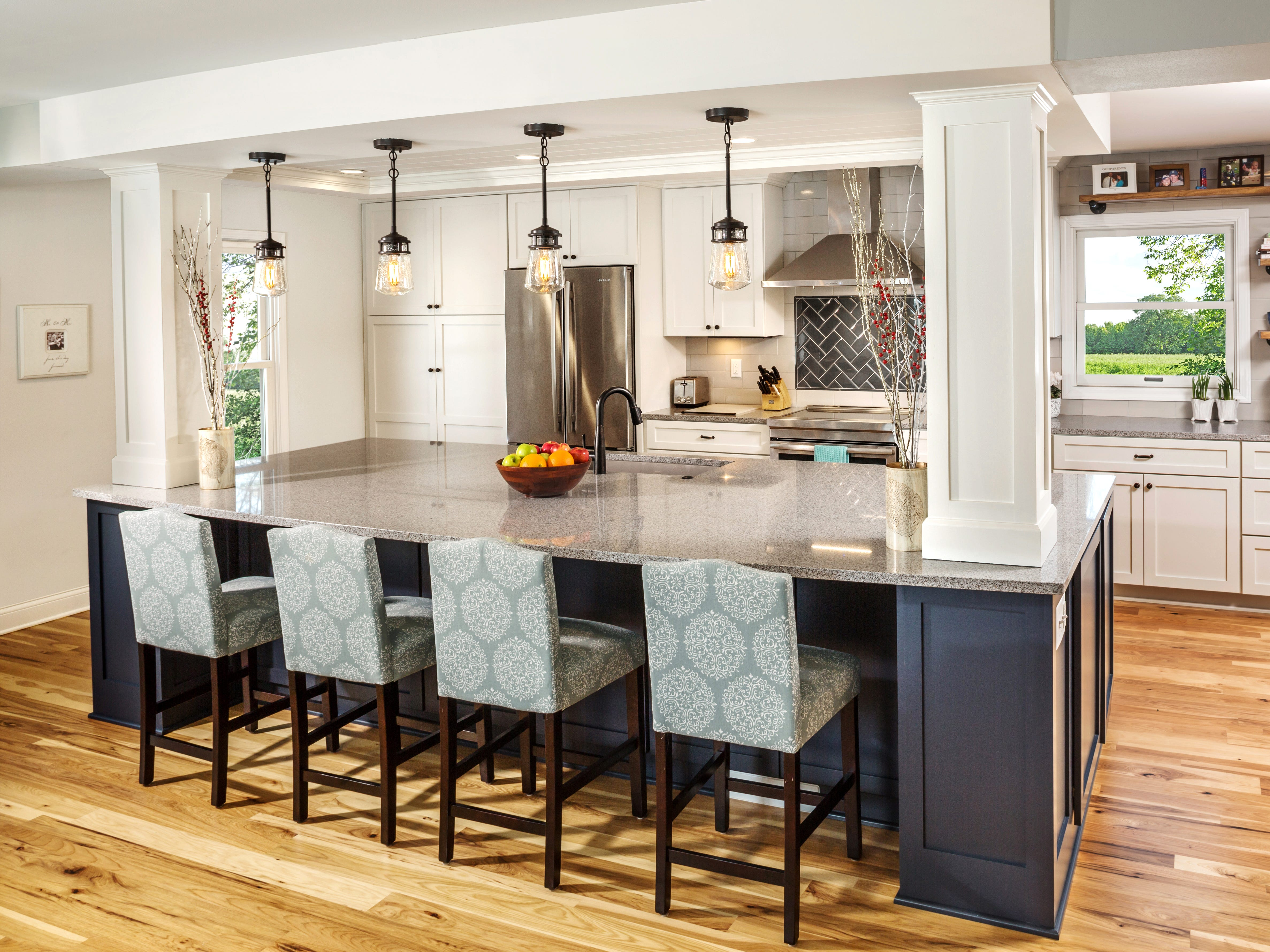 The large 5-by-12-foot island has many functions including storage, food prep and seating, with stools to gather, eat, and keep the guests out of the working area of the kitchen.
