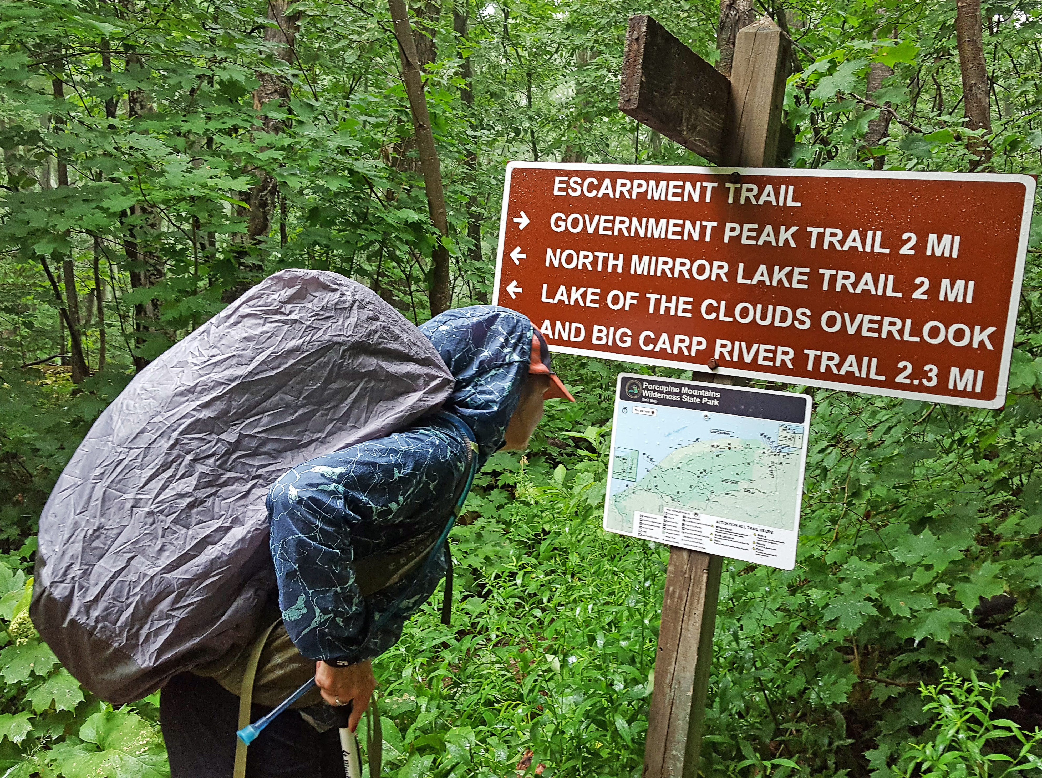 Carol Lewis looks at a map along the Escarpment Trail in the Porcupine Mountains Wilderness State Park in Michigan's Upper Peninsula.
