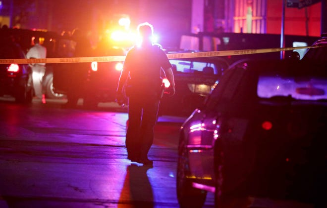 Police investigate the scene of a fatal shooting in Milwaukee this summer.  A local man who took an anger management class after being arrested for domestic violence thinks children in schools would benefit from similar training and would be less likely to pick up a gun in anger.