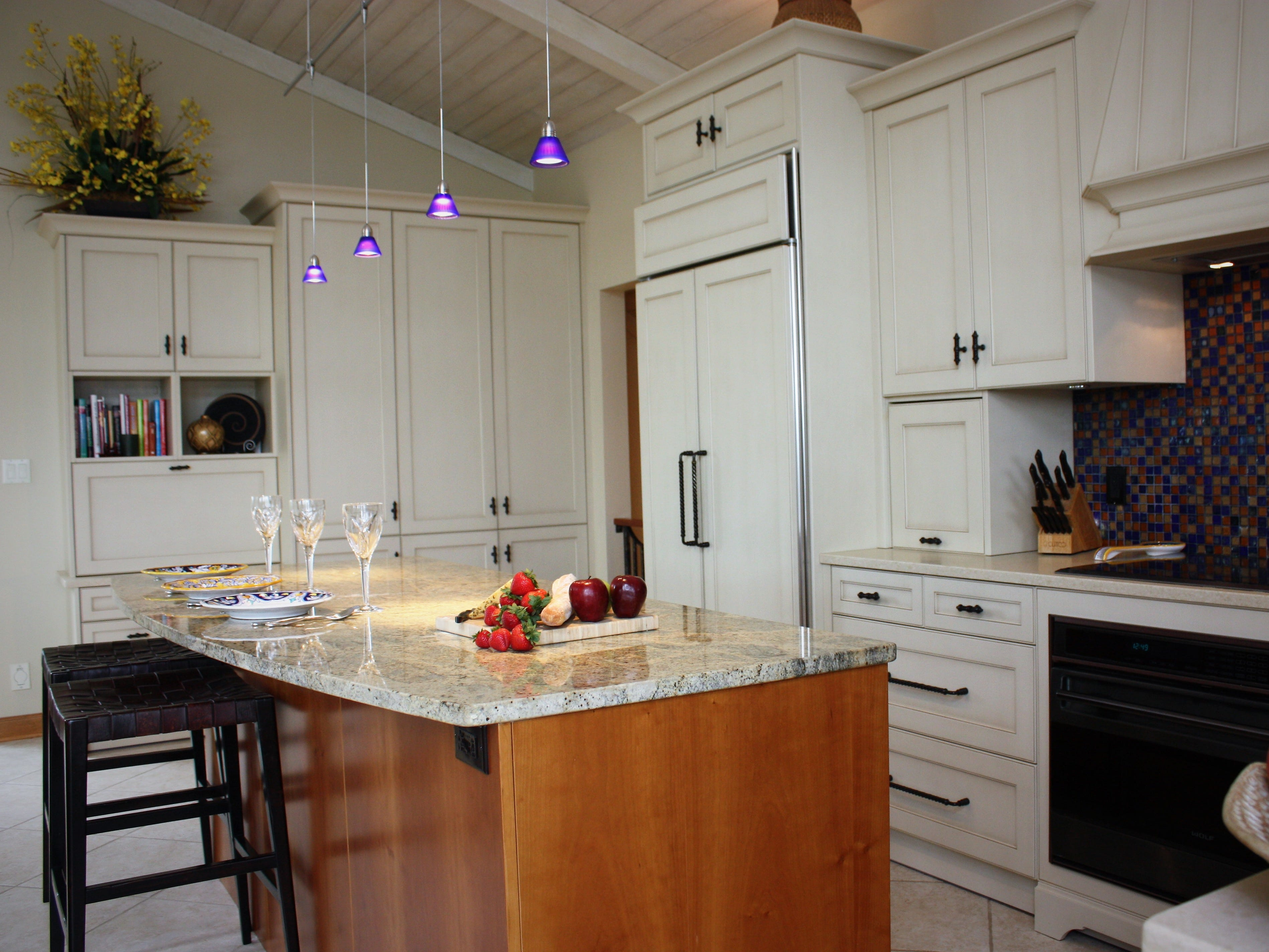 This island in a remodeled lake home in Plymouth was kept free of appliances or sinks to allow for more functional surface area. (NEFF Cabinetry)
