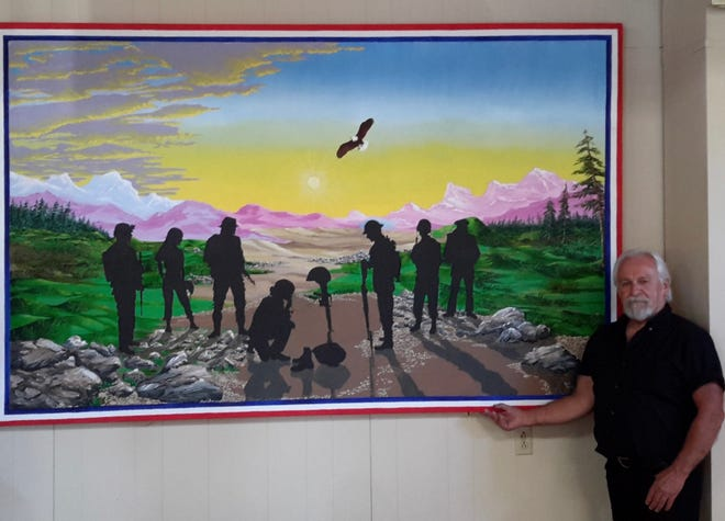 Oconomowoc's Keith Reimer donated an 8-foot mural to the Okauchee Legion Post 399. The mural depicts all branches of the U.S. Armed Forces.