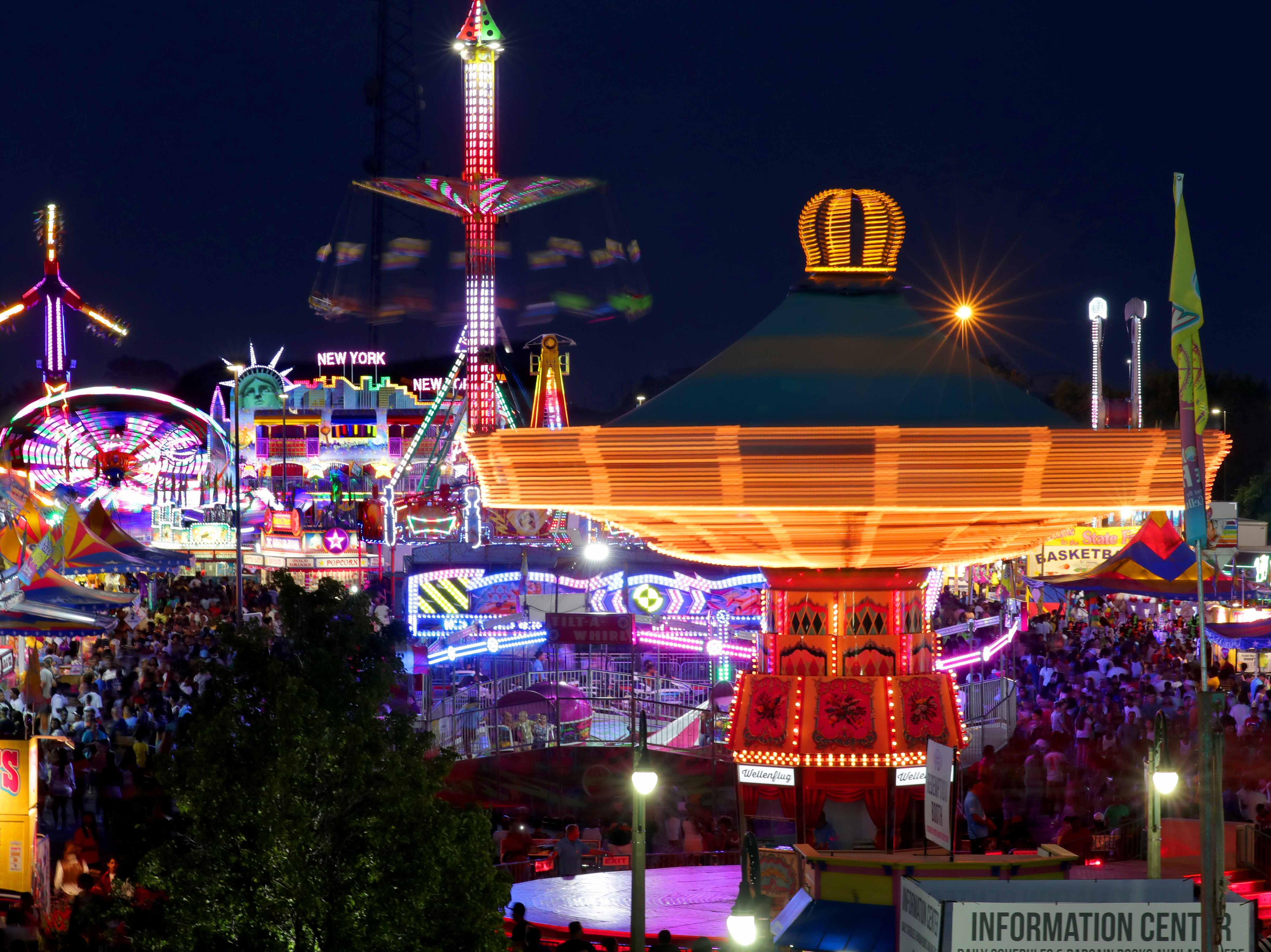 Fairgoers enjoy rides in SpinCity on the final night of the Wisconsin State Fair on  Sunday, Aug. 12, 2018.