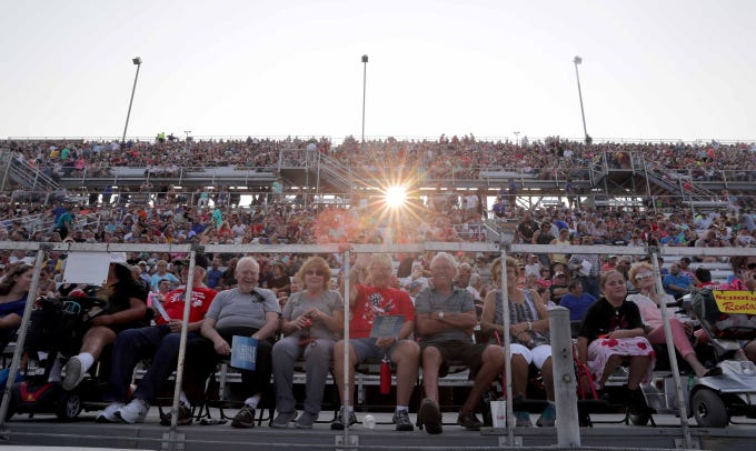 Fans wait in the grandstands as the sun sets before country legend Reba McEntire performs a sold-out show at the Wisconsin State Fair on the Main Stage on the fair's final night Sunday.