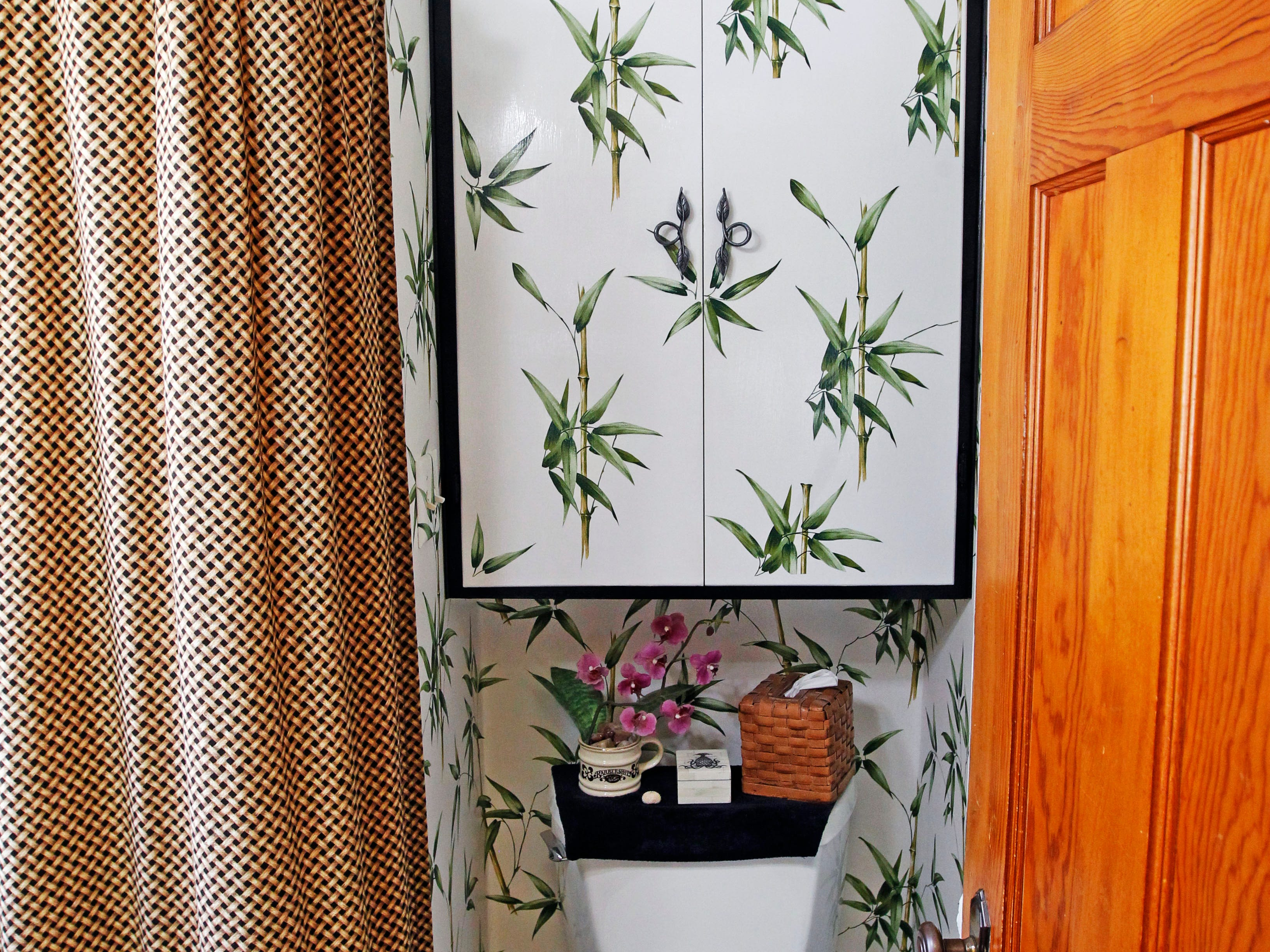 Bamboo print wallpaper accents the downstairs bathroom.