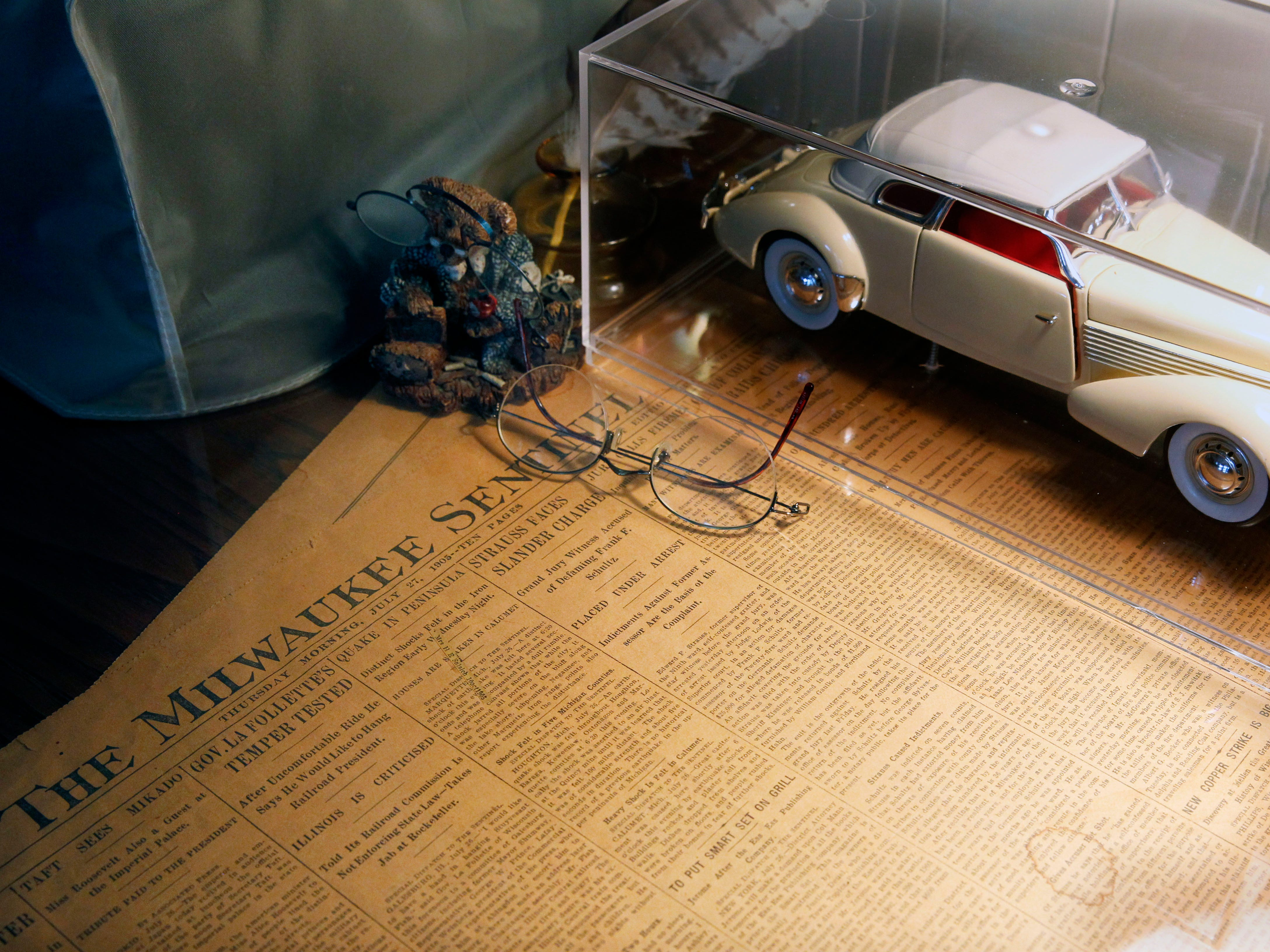 A 1905 Milwaukee Sentinel paper has been preserved under the glass top of an antique partner desk in the guest bedroom.