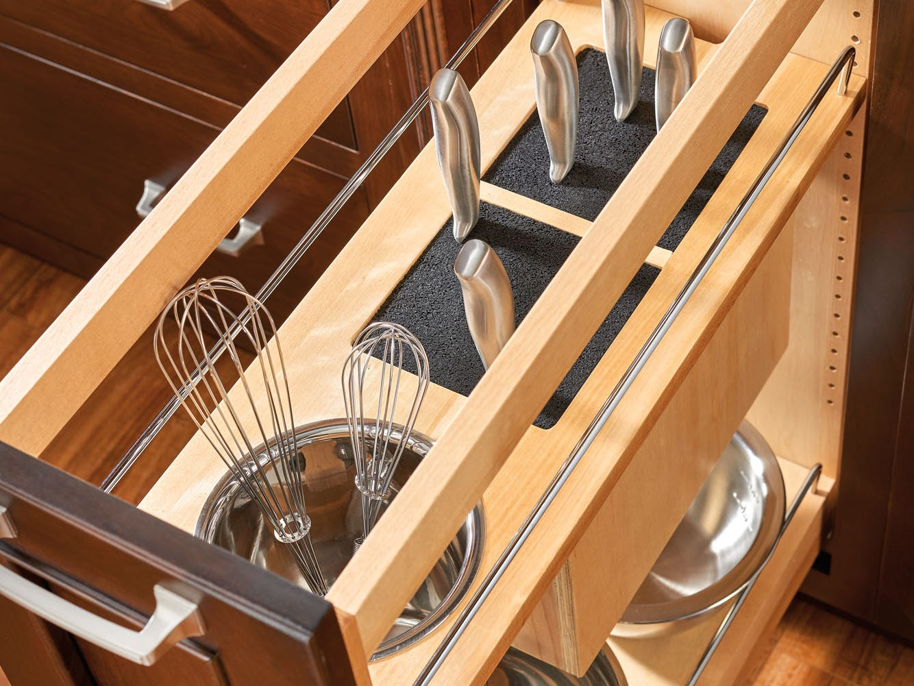 A two-tier pull-out offers knife and utensil storage on top.