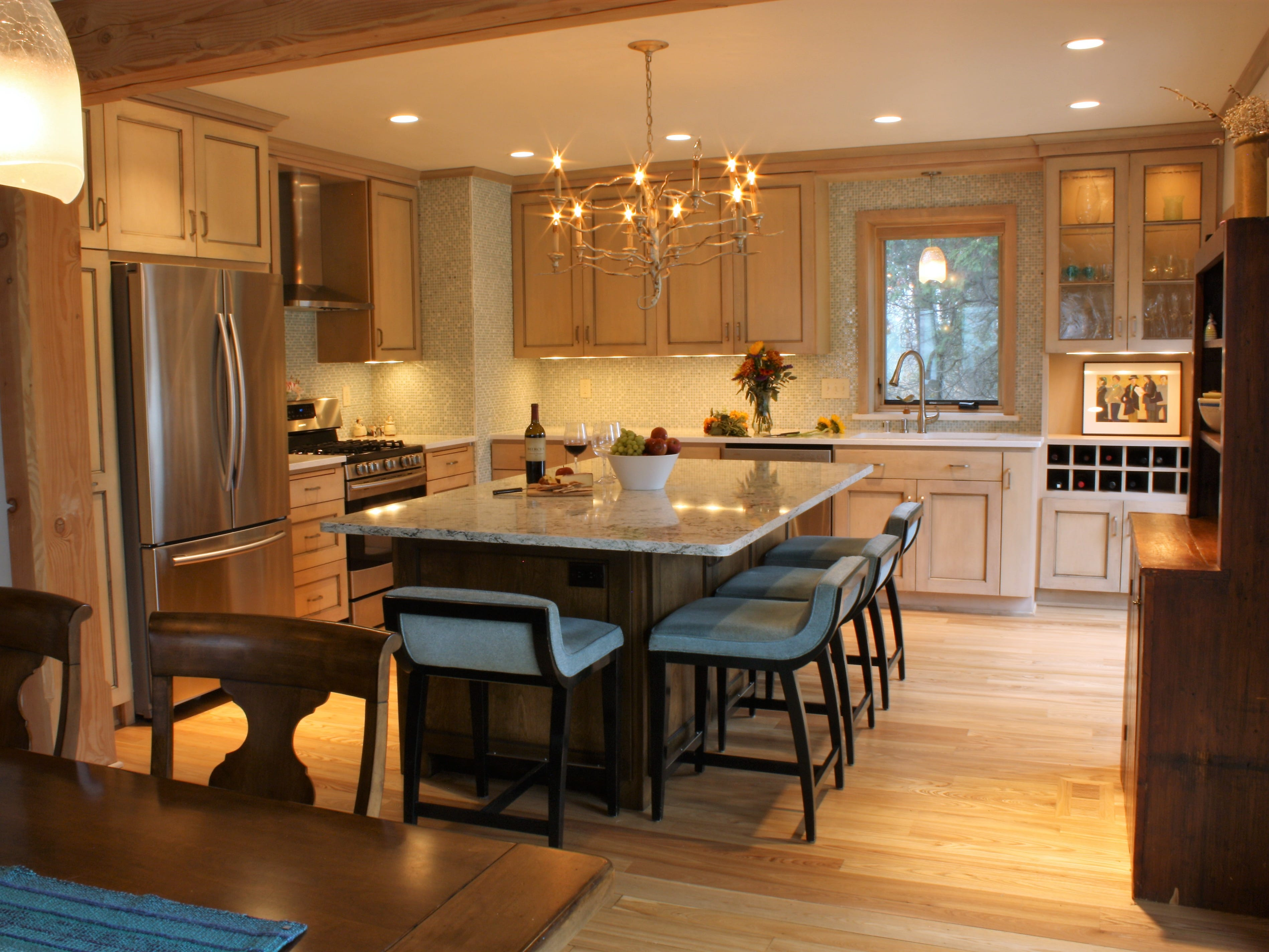 This large kitchen island in Port Washington was designed with a furniture like appearance. It's a gathering spot and also serves as a work surface for quilting and craft projects. (SAP Woodworking)
