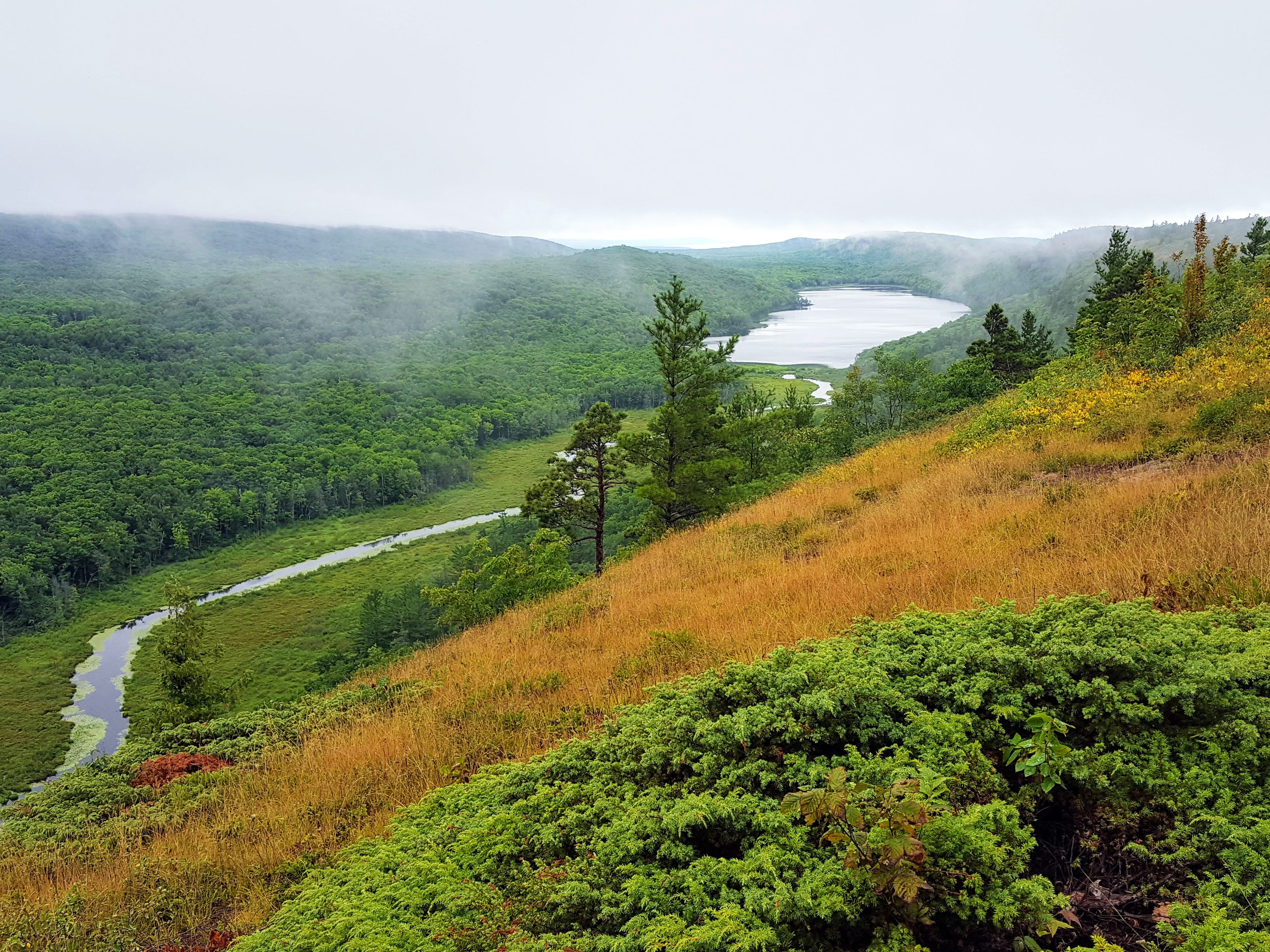 Fog clings to the hillsides around Lake of the Clouds and the Upper Carp River in the Porcupine Mountains Wilderness State Park in Michigan's Upper Peninsula.
