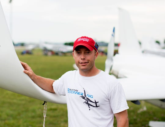 Brookfield native Joe Coraggio stands by a plane. He received the Phillips 66 Aviation's EAA Young Eagles Leadership Award in July.