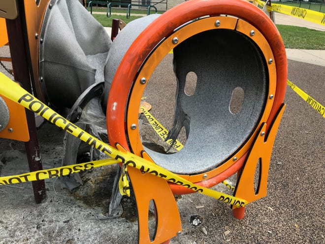 The center of a slide that is also part tunnel was burned away in a fire that was set underneath the play equipment at Liberty Heights Prk, 1540 S. 62nd St., about 12:30 a.m. Aug. 11. Charring from the fire can be seen on the spongy playground surface material.