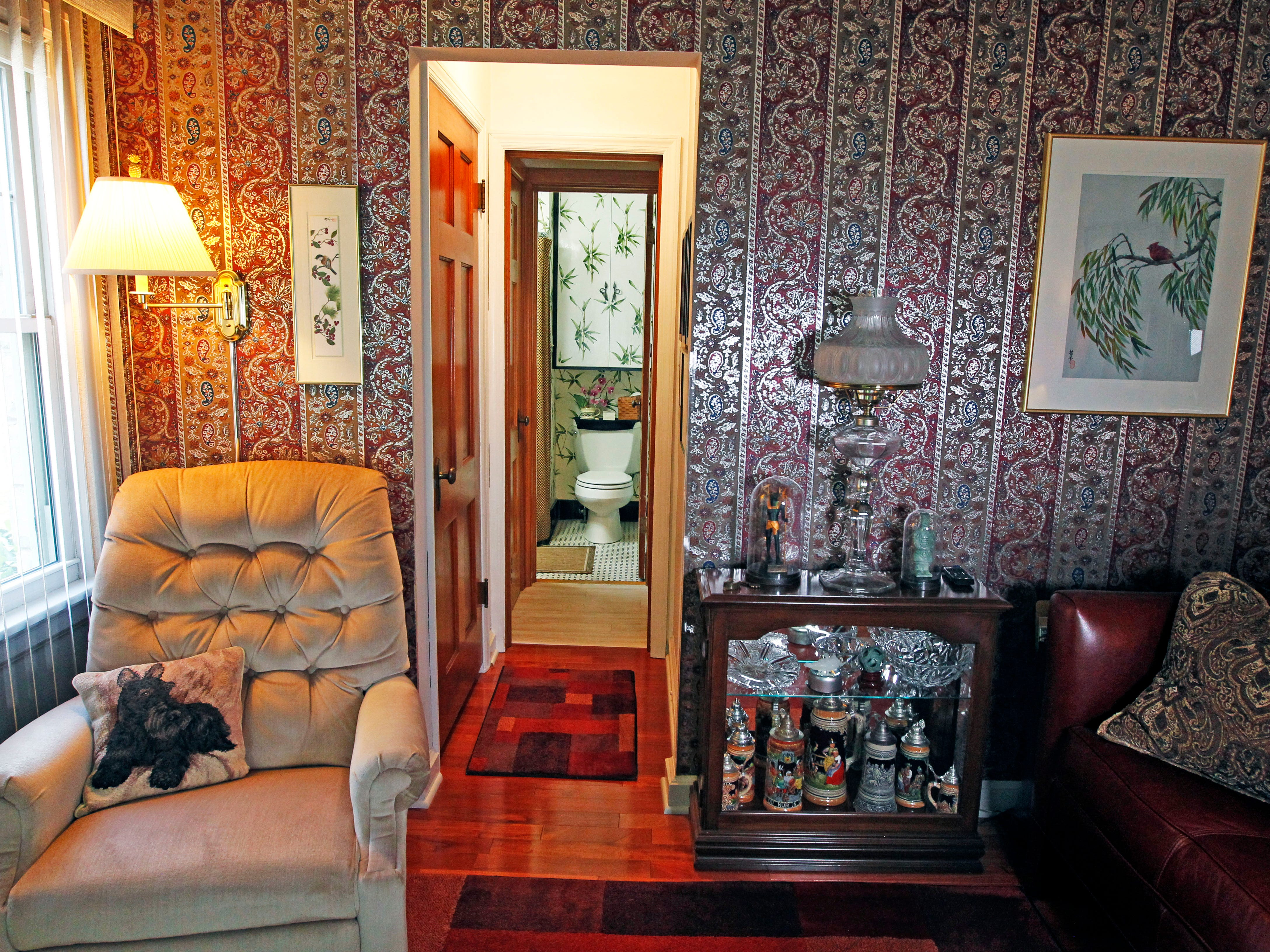 The media room has bold paisley walls and displays many of his world travel souvenirs.