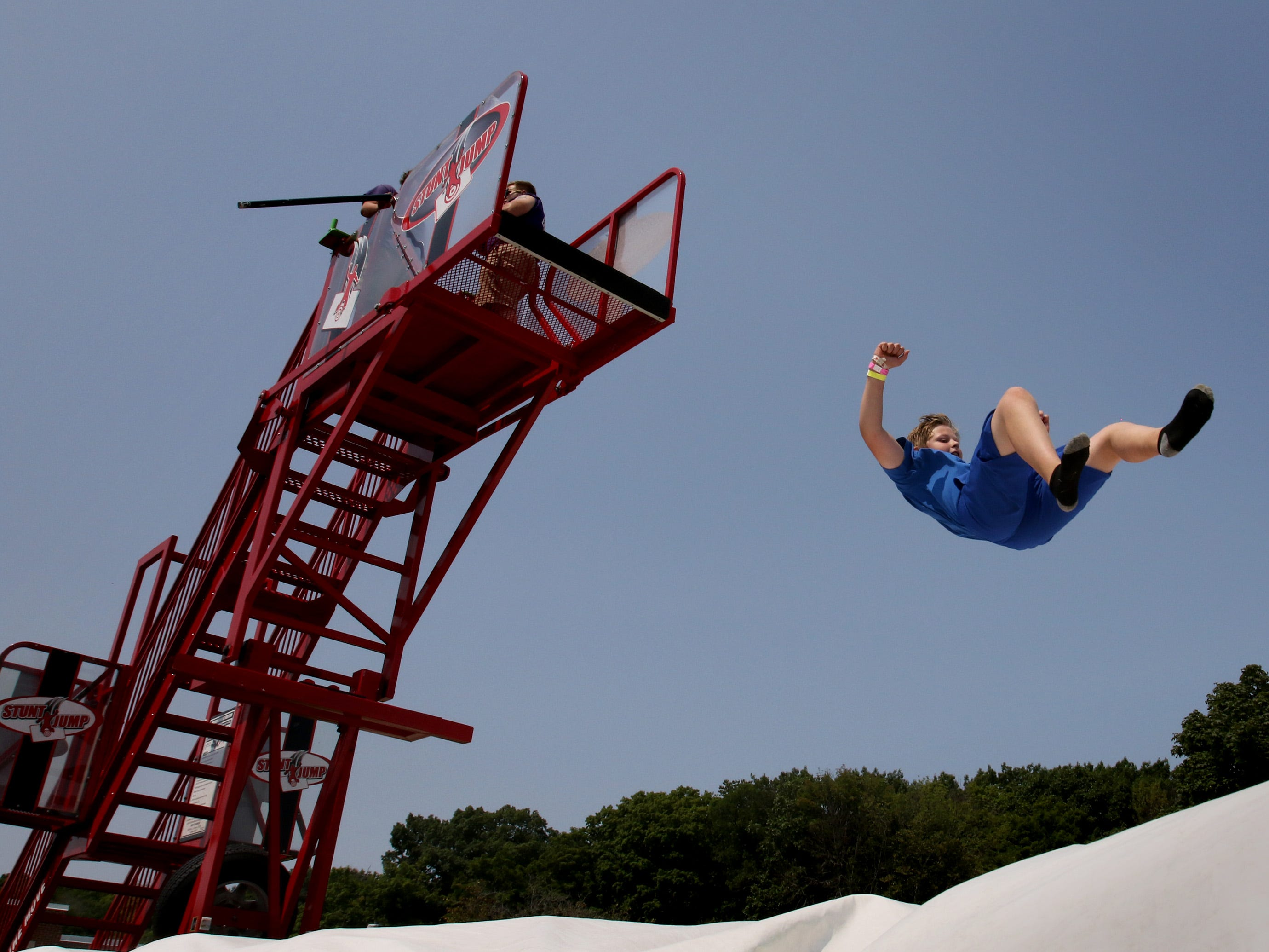 Eric Runkel, 11, makes a leap of faith off the Stunt Jump during his roving act at Greendale Village Days on Aug. 11.
