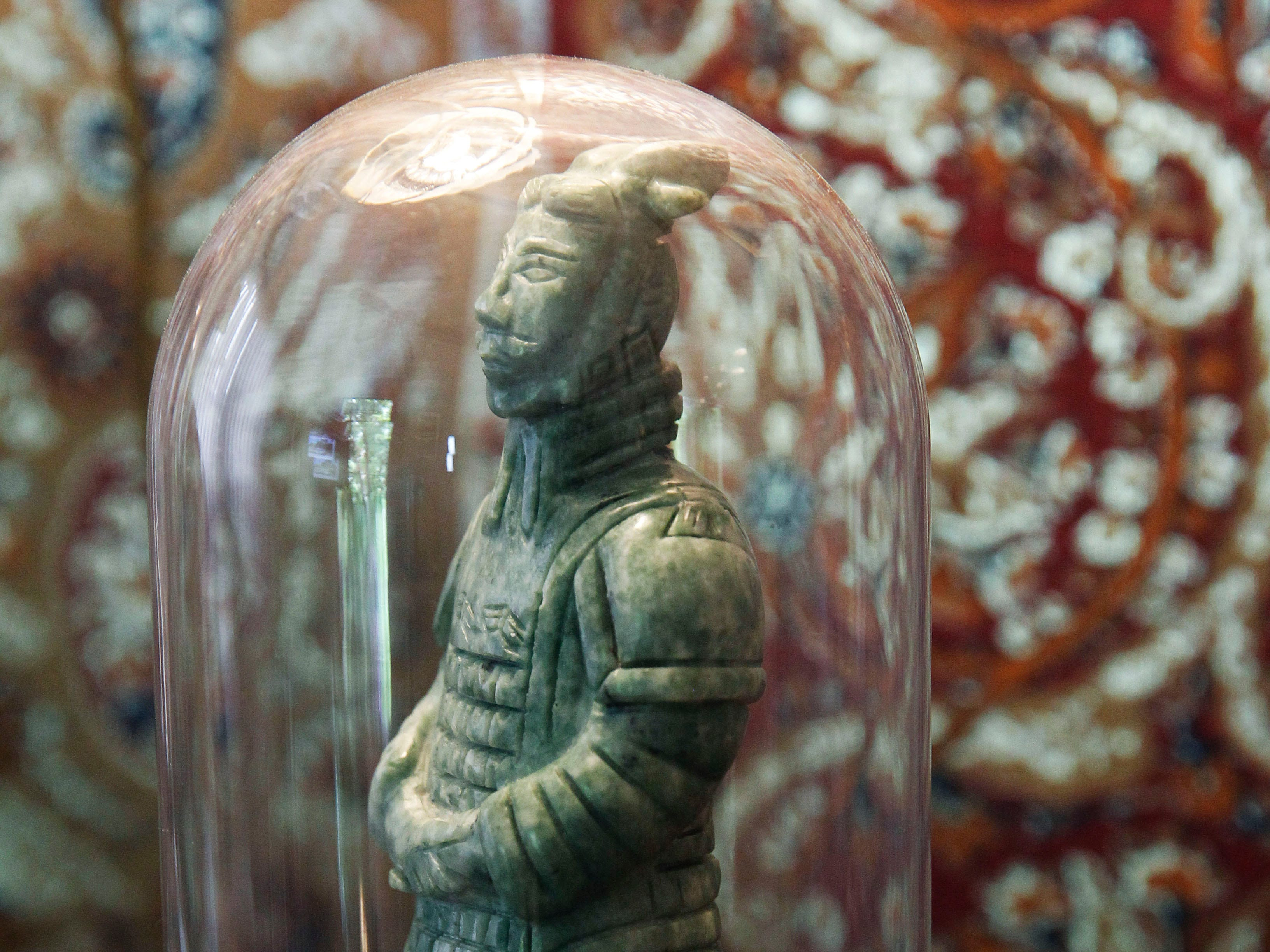 A jade statue of the terra cotta soldier is among the homeowner's  treasured pieces from a visit to China.