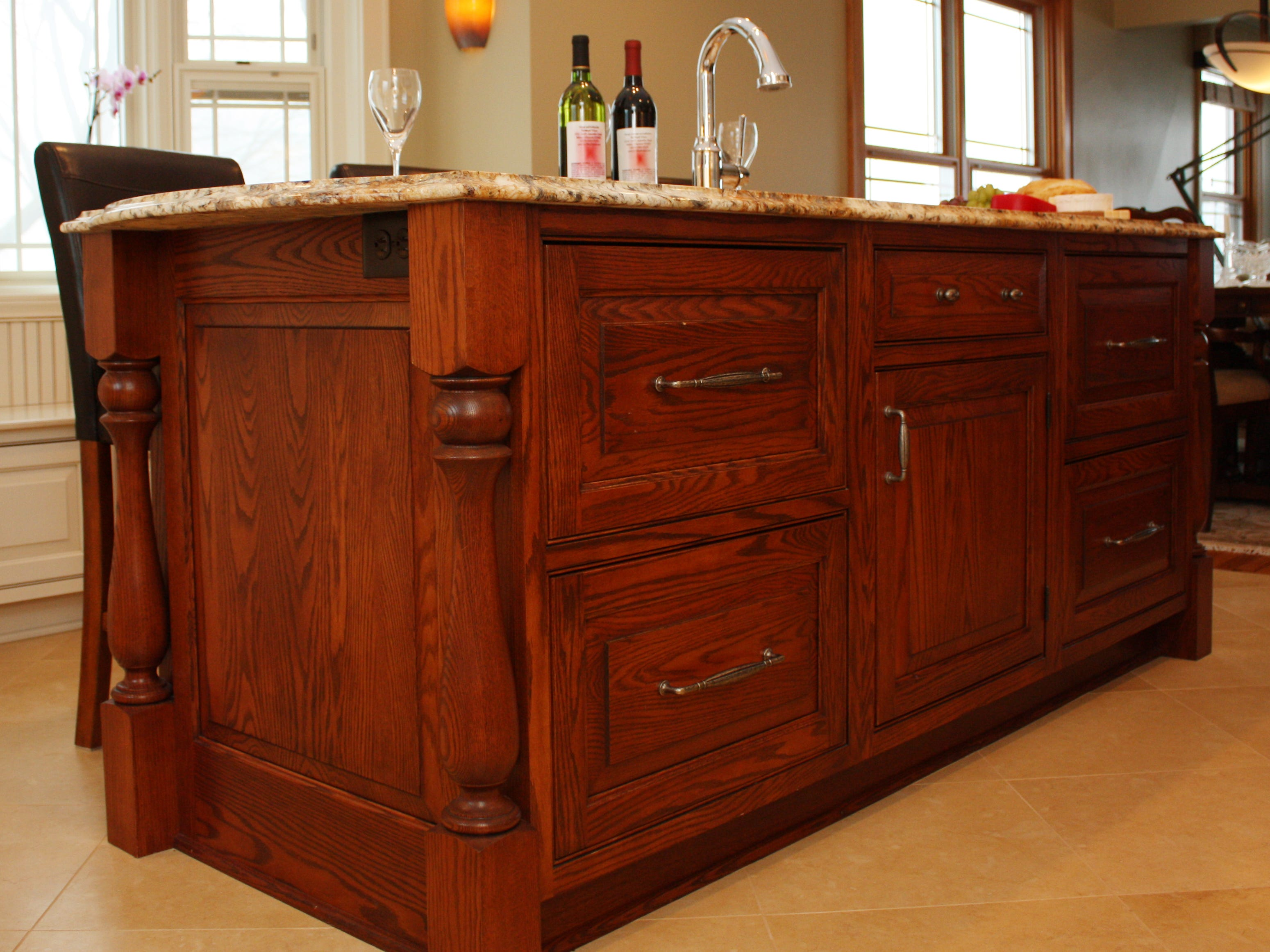 This large island in Milwaukee supports a prep sink as well as functional storage and seating for gathering. (Greenfield Cabinetry)